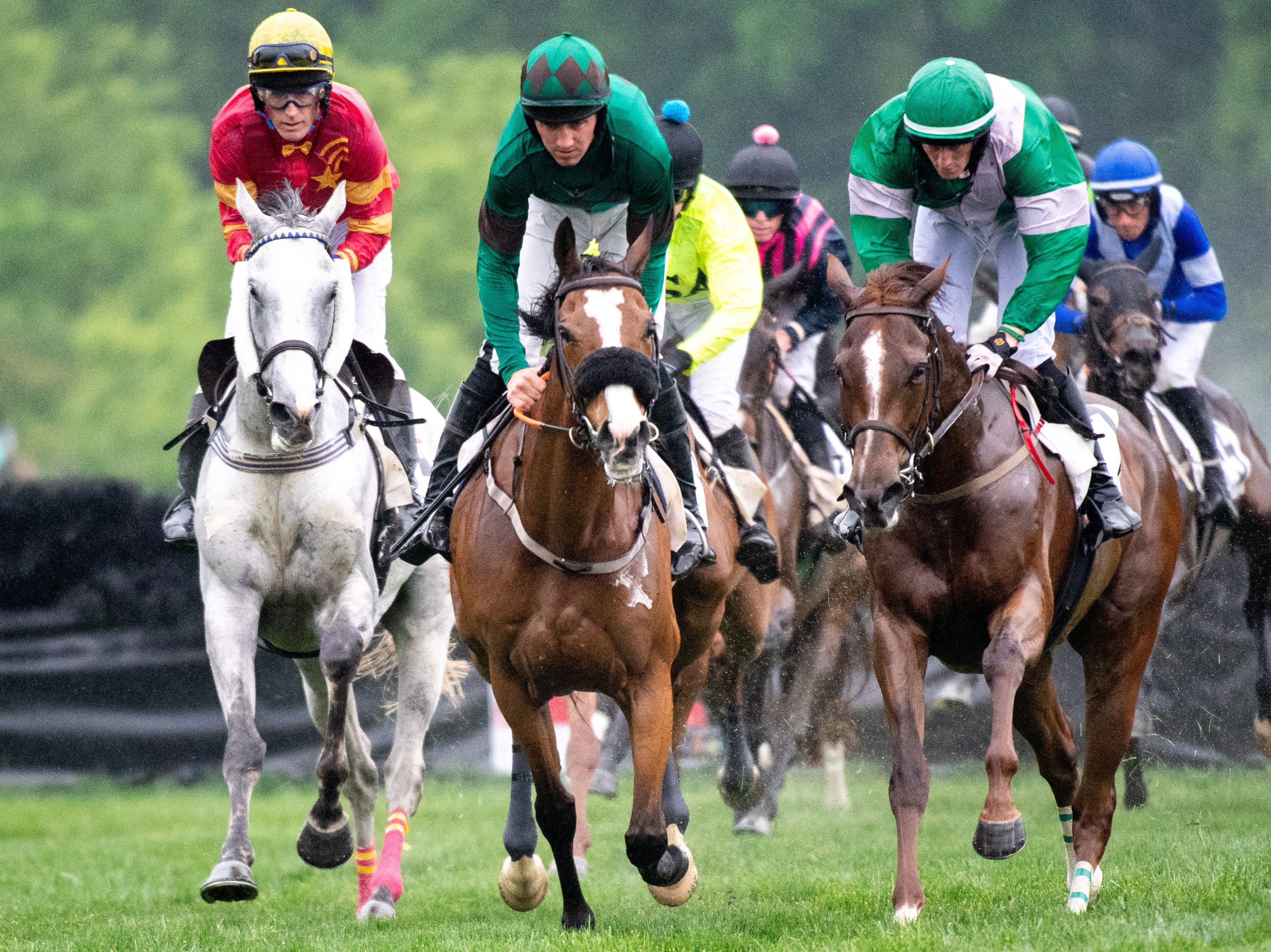 Horses and jockeys compete during the fourth race of the Iroquois Steeplechase at Percy Warner Park Saturday, May 11, 2019, in Nashville, Tenn.