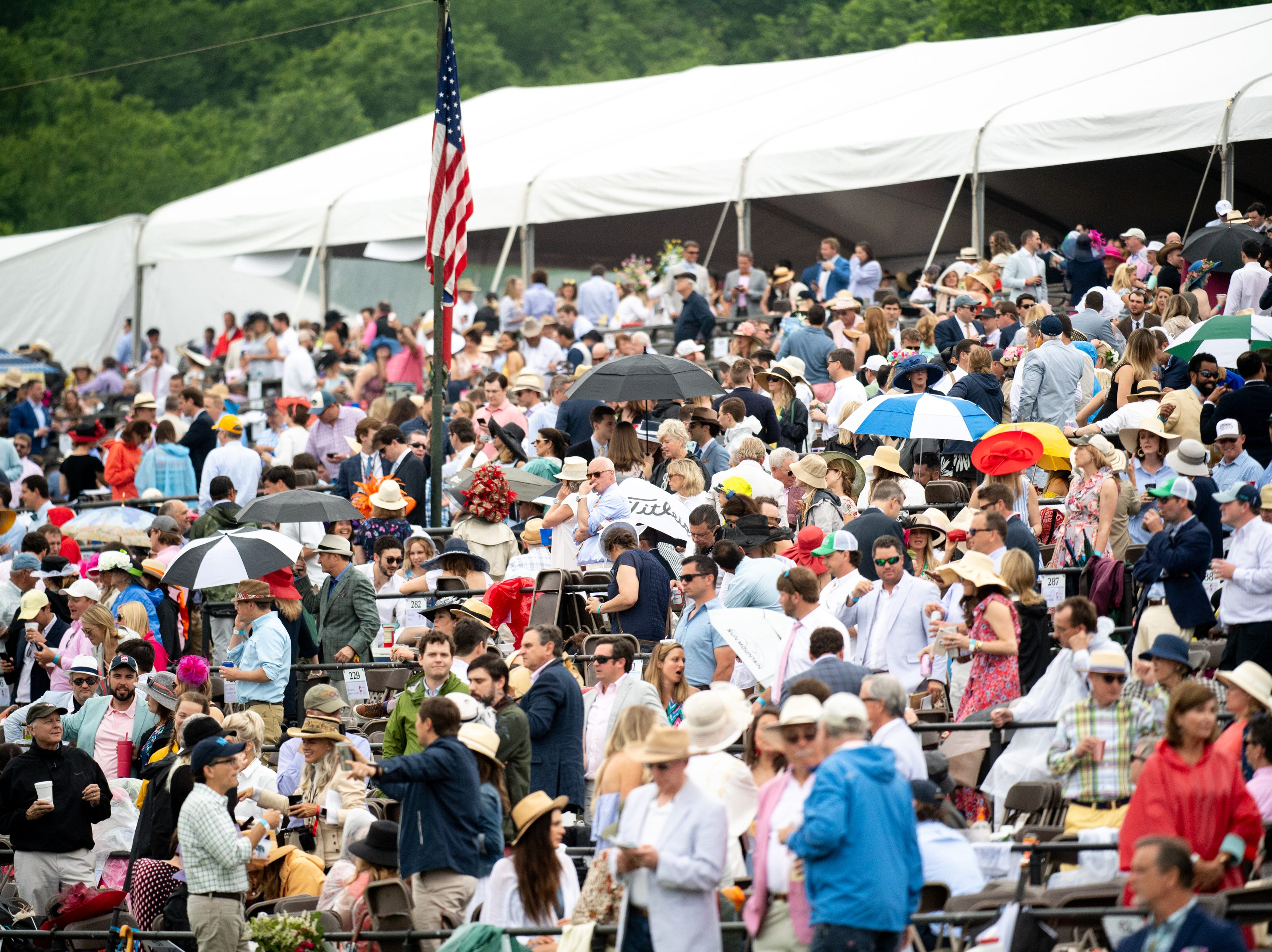 Spectators gather during the third race of the Iroquois Steeplechase at Percy Warner Park Saturday, May 11, 2019, in Nashville, Tenn.