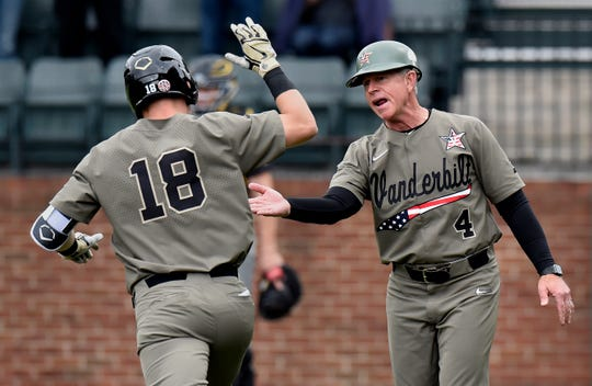 Vanderbilt's Pat DeMarco (18) celebrates with coach Tim Corbin after hitting a home run to left field against Missouri during the second inning Sunday.