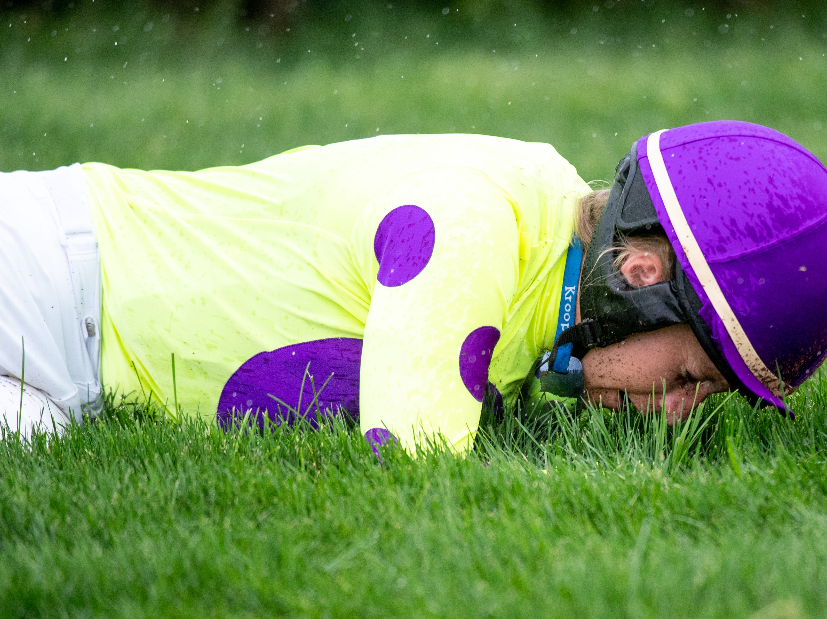 Keri Brion lays on the ground after being thrown from Orchestra Leader during the second race of the Iroquois Steeplechase at Percy Warner Park Saturday, May 11, 2019, in Nashville, Tenn.
