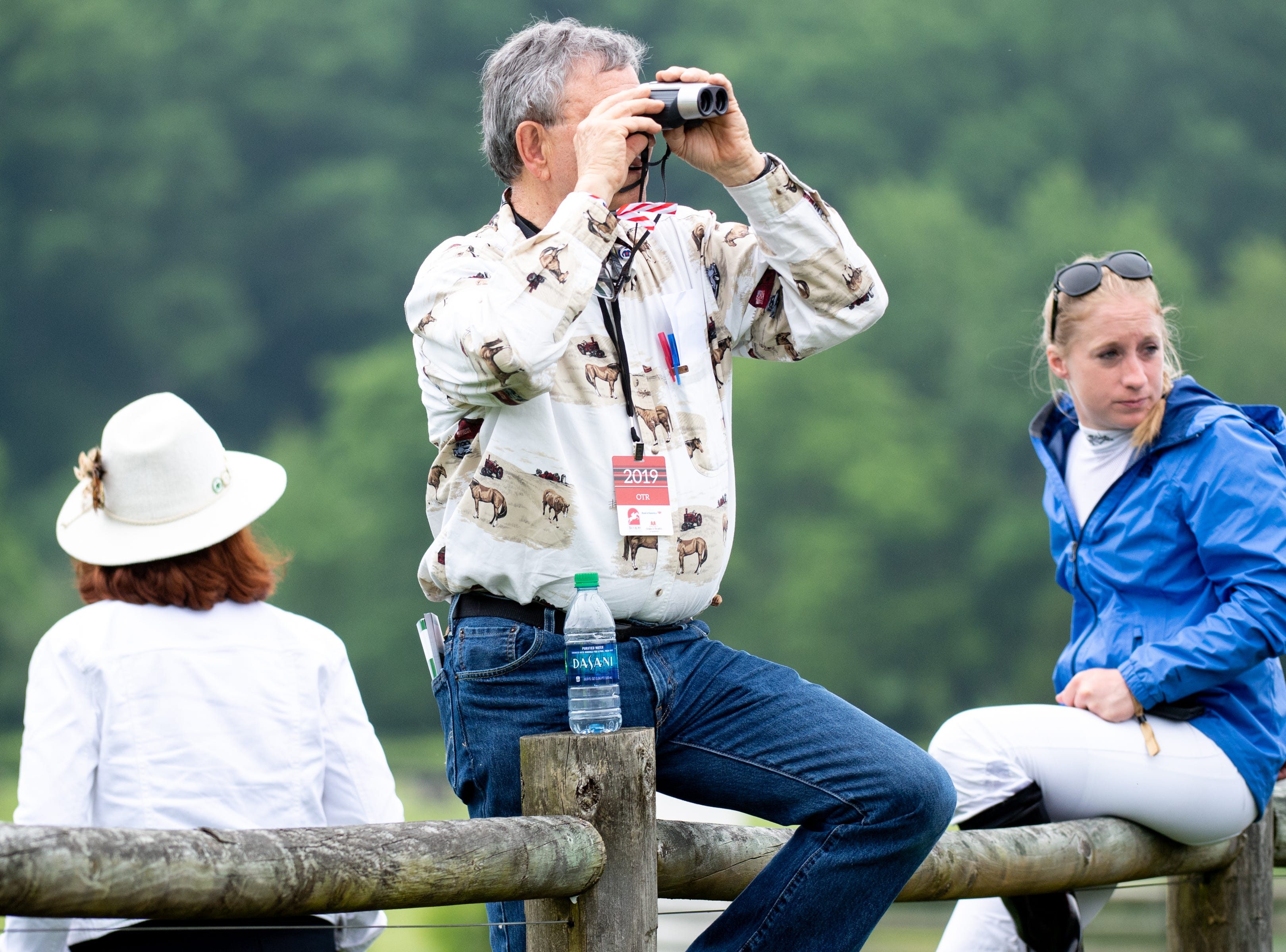 Spectators watch the first race of the Iroquois Steeplechase at Percy Warner Park Saturday, May 11, 2019, in Nashville, Tenn.