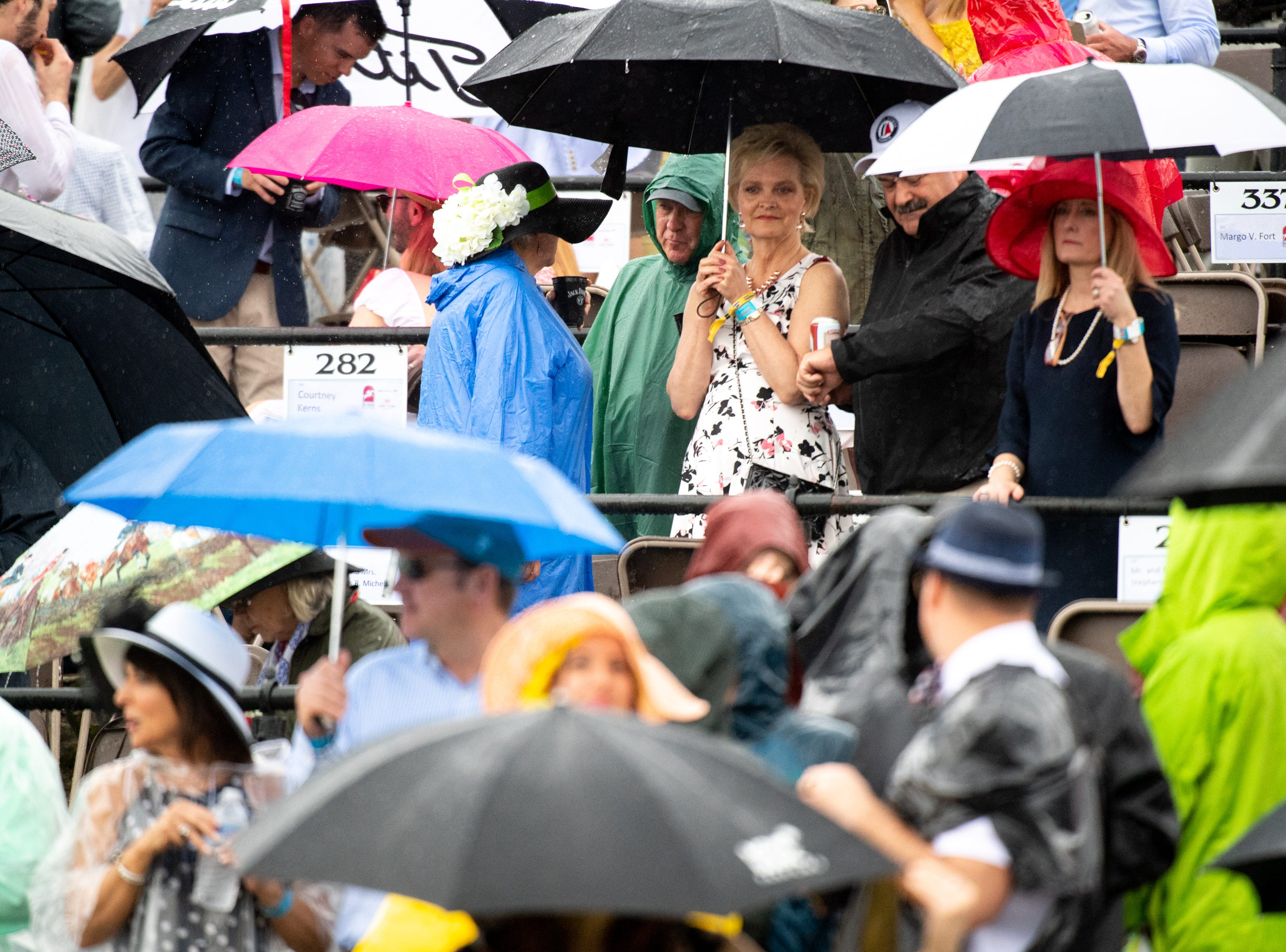 Spectators prepare as it starts to rain during the Iroquois Steeplechase at Percy Warner Park Saturday, May 11, 2019, in Nashville, Tenn.