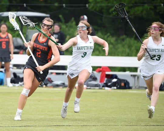 Ensworth's Annabel Frist (2) runs upfield as Harpeth Hall's Margaret Morris defends during Ensworth's 11-8 win over Harpeth Hall in the Tennessee lacrosse private school state championship on Saturday at Ensworth.