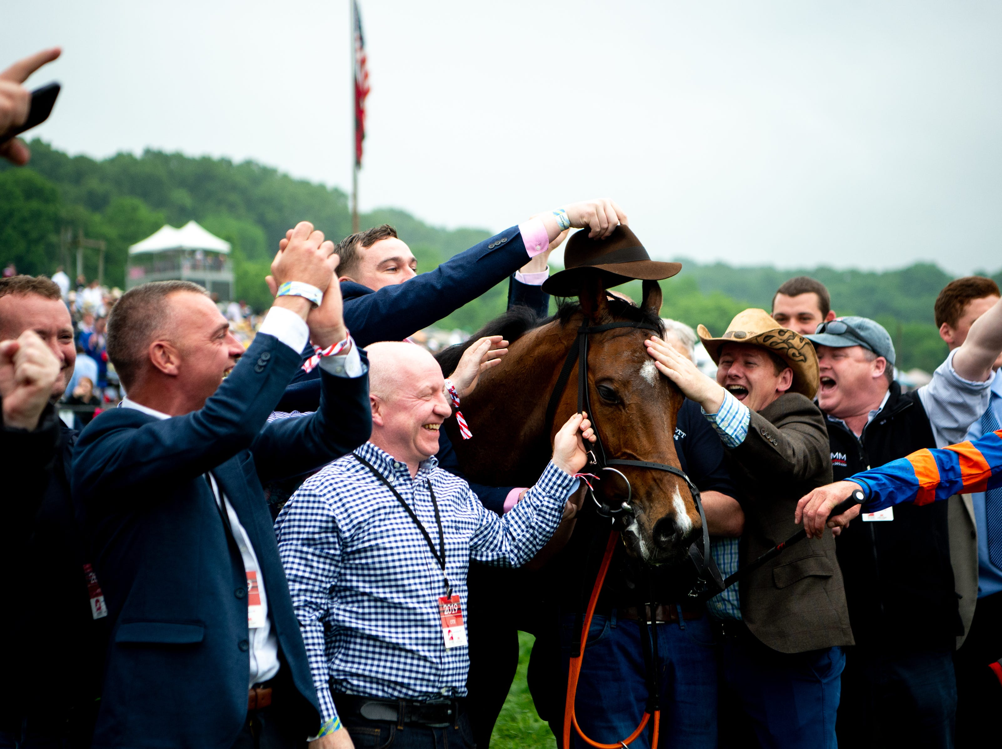 Markhan is celebrated after winning the fifth race of the Iroquois Steeplechase at Percy Warner Park Saturday, May 11, 2019, in Nashville, Tenn.