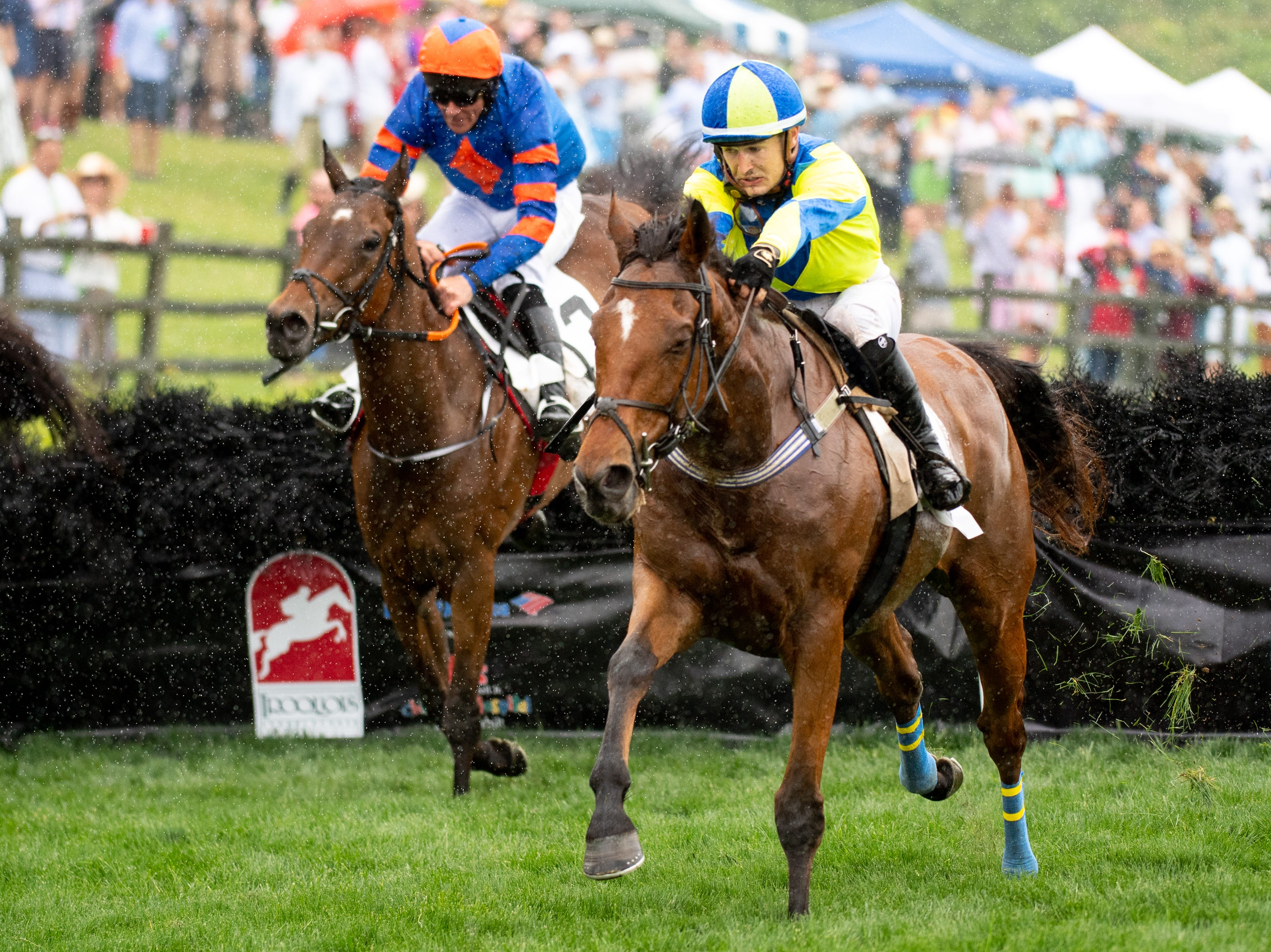Michael Mitchell and Lord Justice, right, speed ahead from Jack Kennedy and Stooshie during the second race of the Iroquois Steeplechase at Percy Warner Park Saturday, May 11, 2019, in Nashville, Tenn.