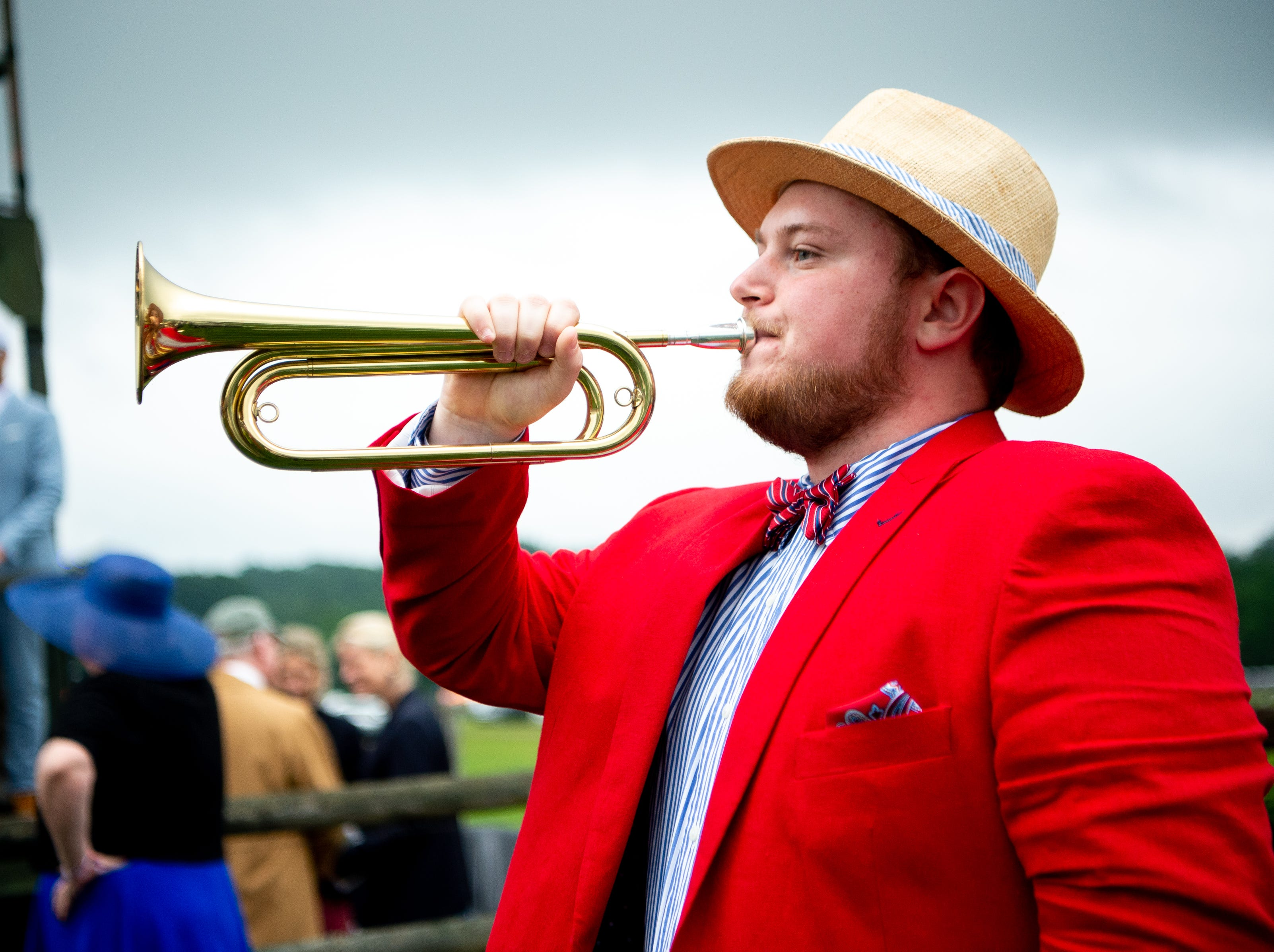 """Samuel Hickerson plays the """"Call to Post"""" before the fifth race of the Iroquois Steeplechase at Percy Warner Park Saturday, May 11, 2019, in Nashville, Tenn."""