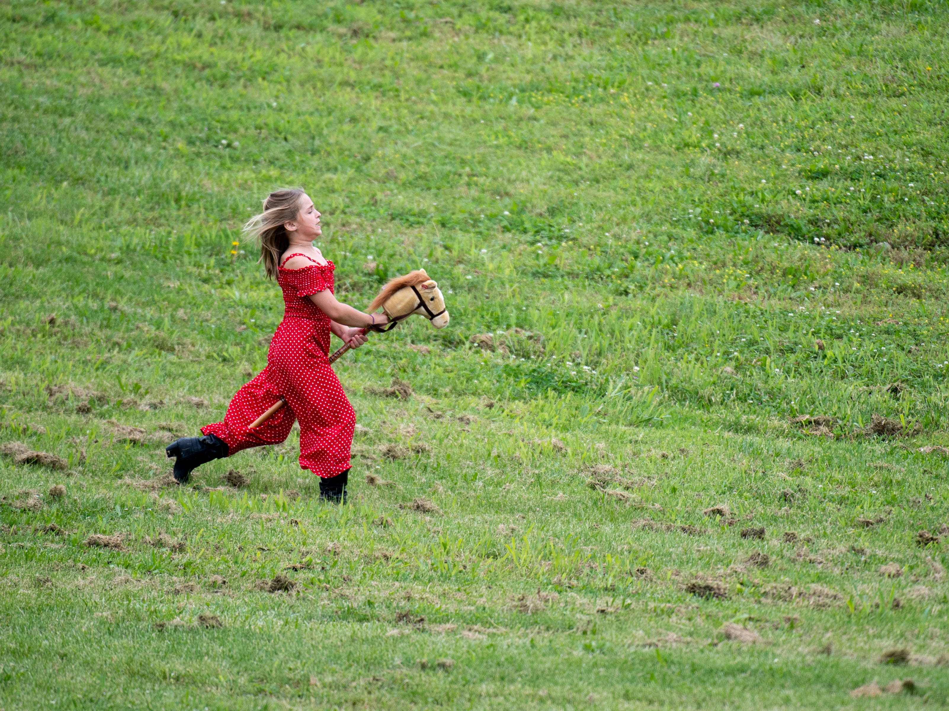 A girl plays during the Iroquois Steeplechase at Percy Warner Park Saturday, May 11, 2019, in Nashville, Tenn.