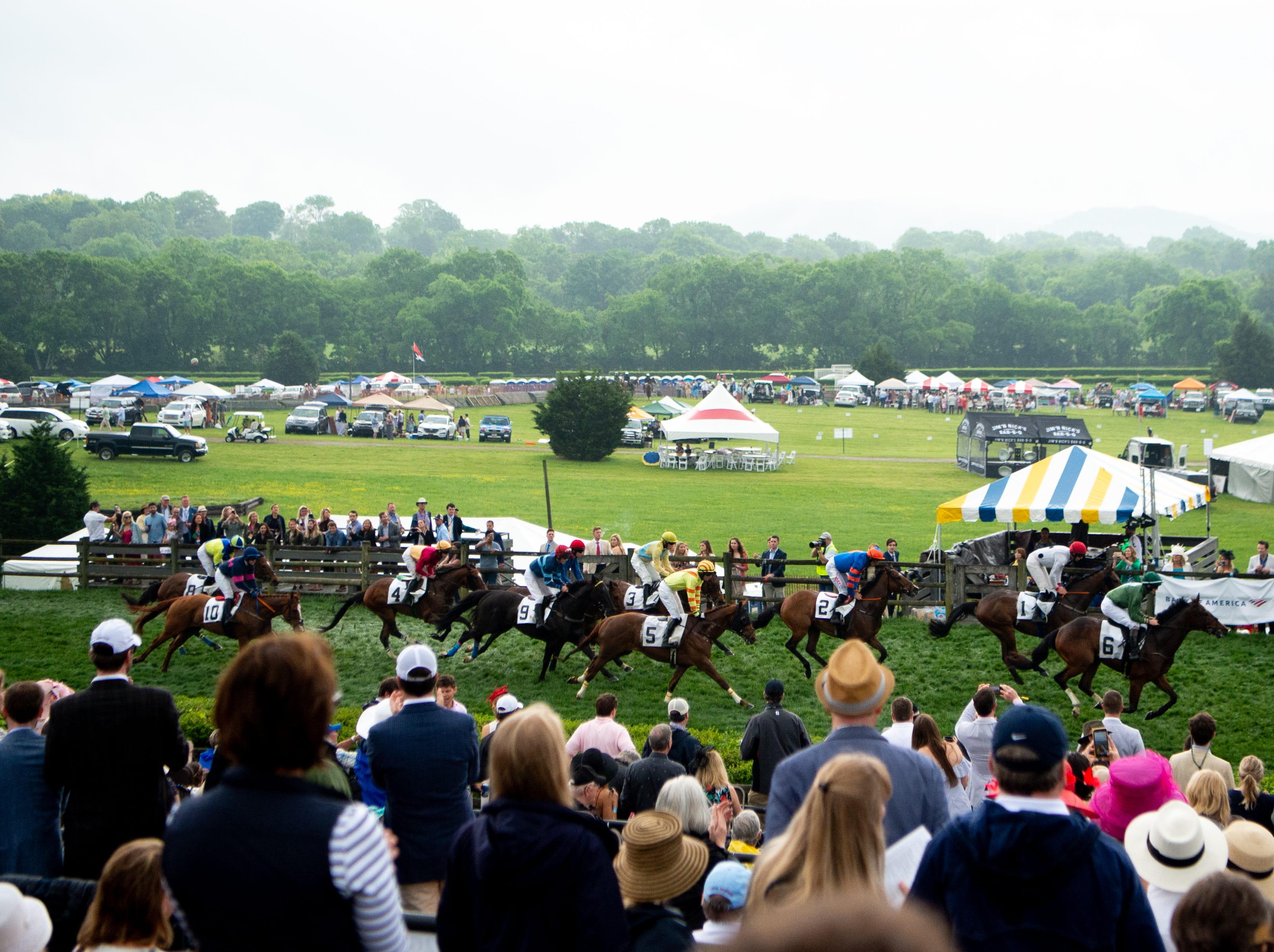Horses and jockeys compete during the fifth race of the Iroquois Steeplechase at Percy Warner Park Saturday, May 11, 2019, in Nashville, Tenn.