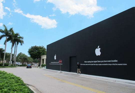 The Apple store at Waterside Shops in Naples looks similar to an iPhone box while under construction on the eastern edge of the mall in preparation for its reopening this fall.