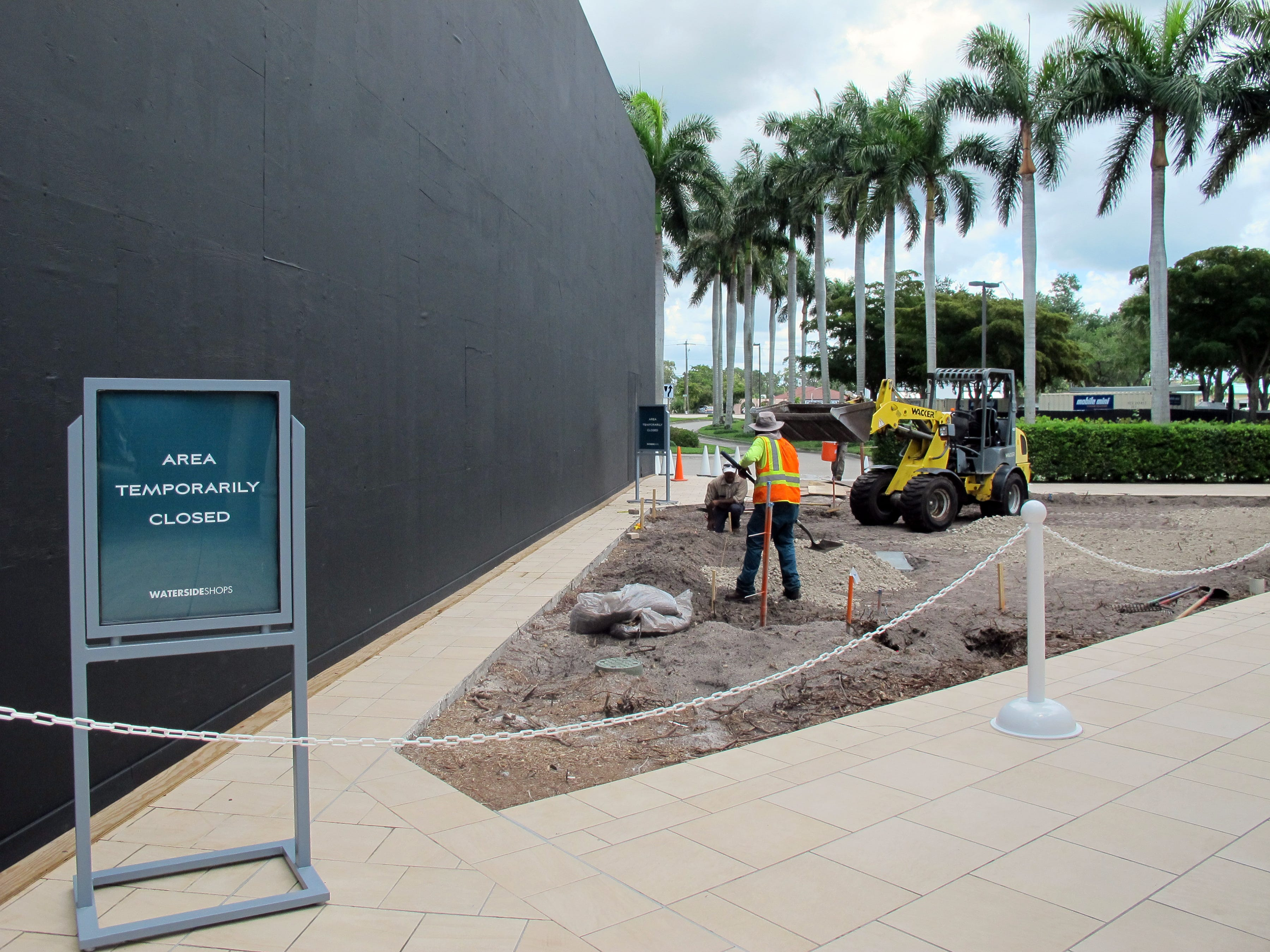The Apple store at Waterside Shops in Naples looks similar to an iPhone box, left, while under construction on the eastern edge of the mall in preparation for its reopening this fall.