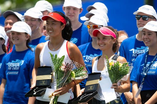 Ann Li, ,left, and Lauren Davis pose for photos at the conclusion of the FineMark Women's Pro Championship women's singles finals  at the Bonita Bay Club in Bonita Springs. Davis defeated Li in two sets to win the women's singles finals on Sunday.