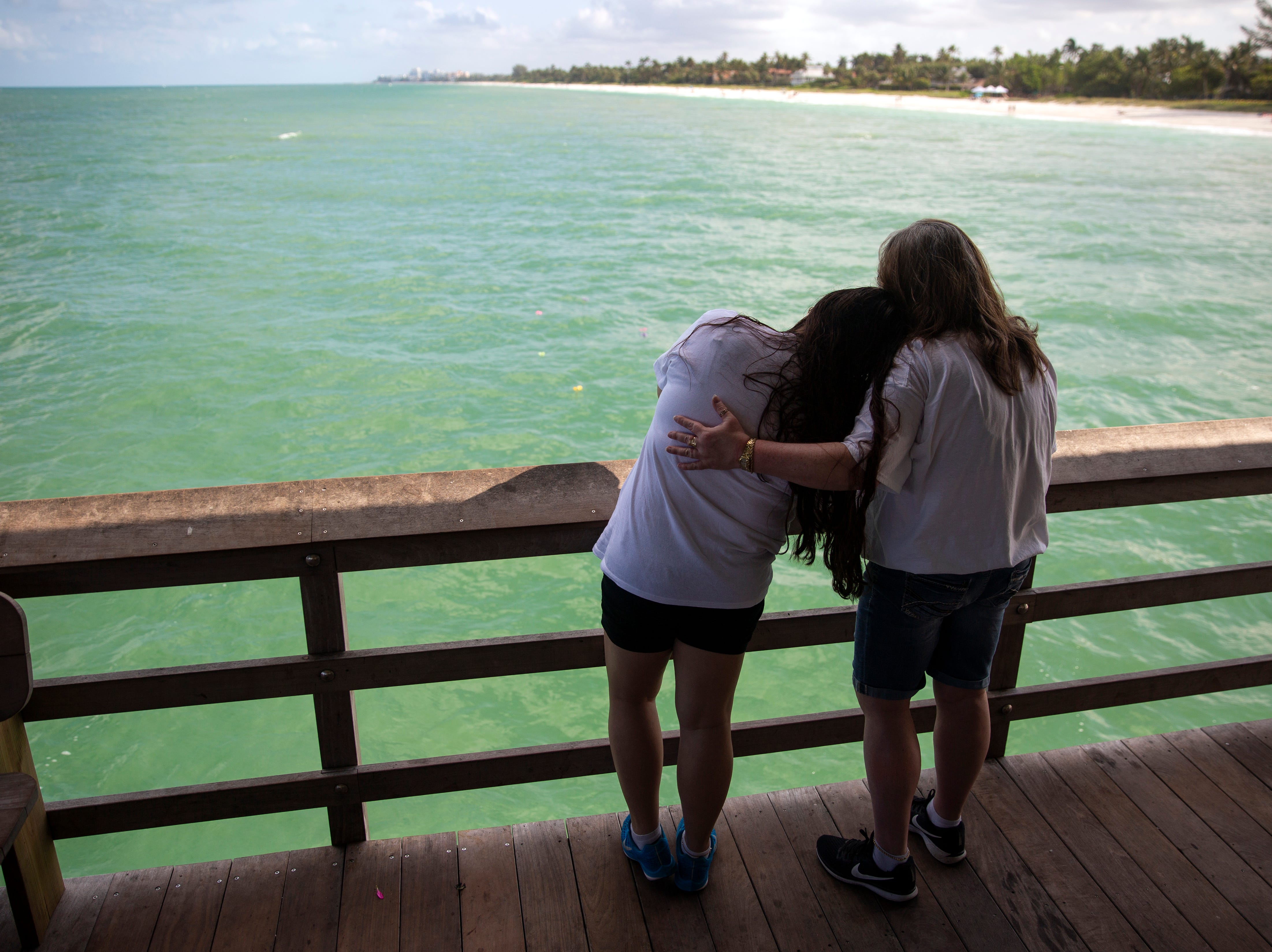 Holly Vingson, left, Naples is comforted by her mother Kelley Vingson also of Naples as they remember Holly's son 6-year old AJ Ruiz during the annual Moms' Celebration of Life event, Sunday, May 12, 2109, at the Naples Pier.