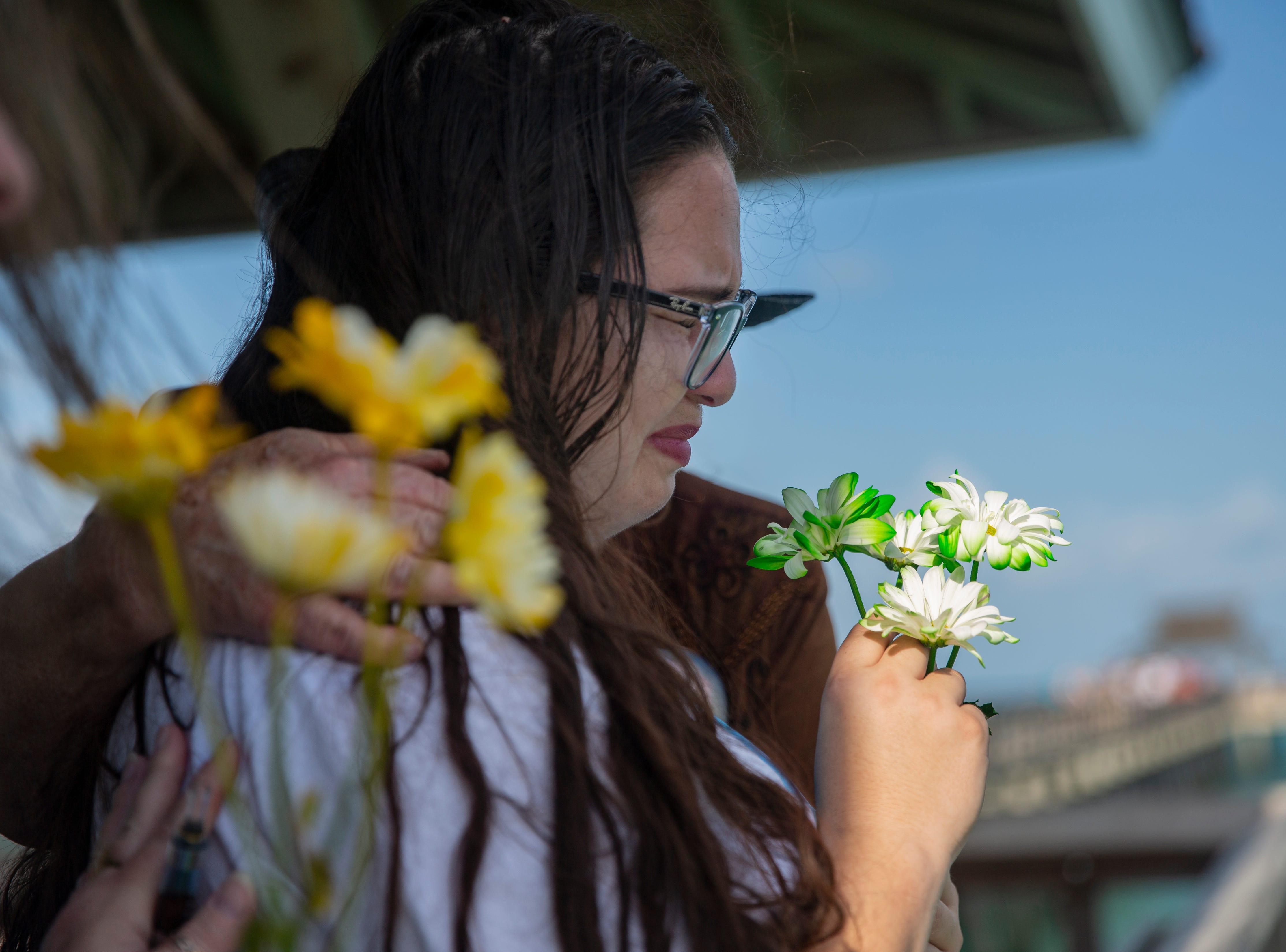 Holly Vingson is comforted as she remember her son, 6- year old AJ Ruiz during the annual Moms' Celebration of Life event, Sunday, May 12, 2109, at the Naples Pier.
