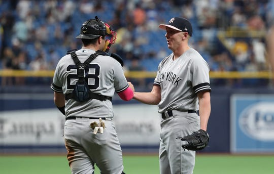 May 12, 2019; St. Petersburg, FL, USA; New York Yankees catcher Austin Romine (28) and pitcher Chad Green (57) celebrate after defeating the Tampa Bay Rays at Tropicana Field.