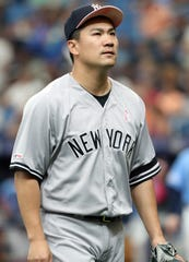 May 12, 2019; St. Petersburg, FL, USA; New York Yankees starting pitcher Masahiro Tanaka (19) looks on at the end of the second inning against the Tampa Bay Rays at Tropicana Field.