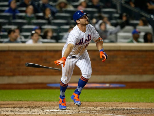 May 11, 2019; New York City, NY, USA;  New York Mets first baseman Pete Alonso (20) tosses his bat after hitting a home run in the sixth inning against the Miami Marlins at Citi Field.