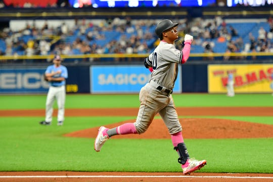 Thairo Estrada #30 of the New York Yankees hit a homer off of Austin Pruitt #45 of the Tampa Bay Rays in the ninth inning at Tropicana Field on May 12, 2019 in St Petersburg, Florida.