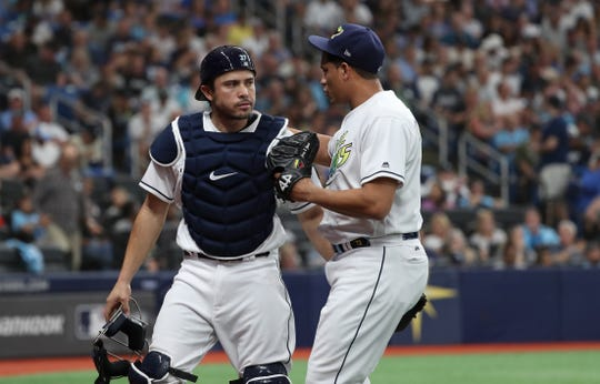 May 11, 2019; St. Petersburg, FL, USA; Tampa Bay Rays catcher Travis d'Arnaud (37) and relief pitcher Yonny Chirinos (72) talk at the end of the third inning against the New York Yankees at Tropicana Field.