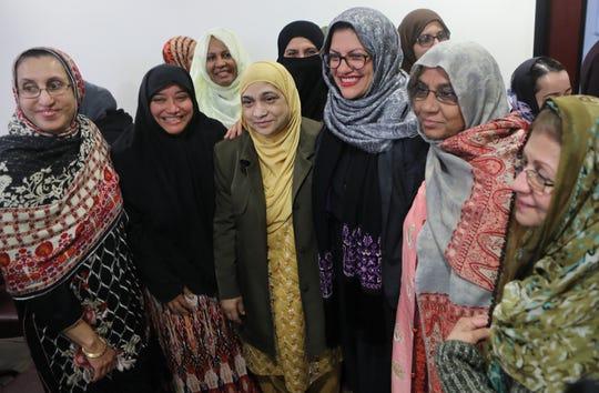 Congresswoman Rashida Tlaib (foreground, grey hijab), of Michigan, pose with well- wishers from Dar Ul Islah in Teaneck.  Sunday, May 12, 2019