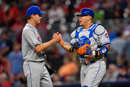 New York Mets pitcher Seth Lugo, here with catcher Wilson Ramos, has stranded all six of the runners he's inherited this season. He's posted a 1.33 ERA with 24 strikeouts since April 7.