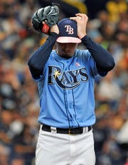 Tampa Bay Rays starter Blake Snell adjusts his cap between pitches during the fifth inning of a game against the New York Yankees, Sunday, May 12, 2019, in St. Petersburg, Fla.