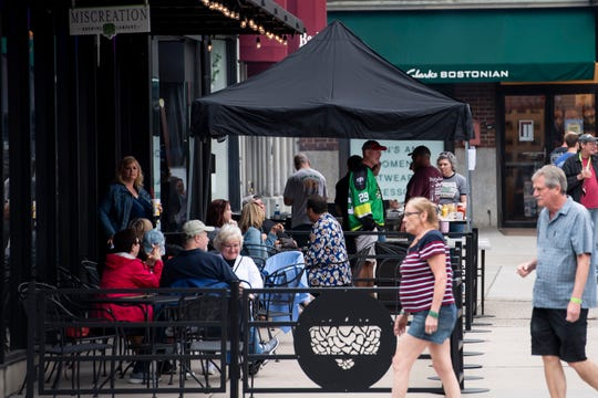 People enjoy the outside seating available at Miscreation Brewing Company in Hanover on Saturday, May 11, 2019.