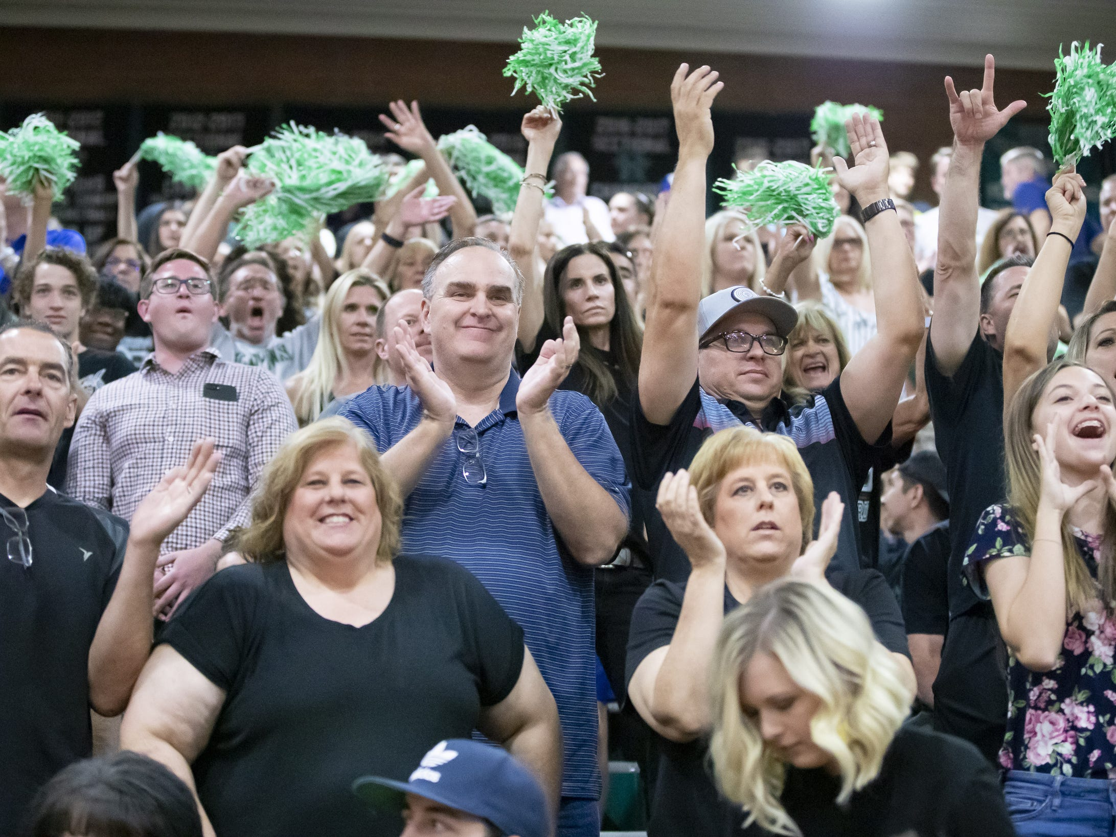 Campo Verde Coyotes fans cheer during the 5A Boys Volleyball State Championships against the Tucson Mountain View Mountain Lions at Higley High School on Saturday, May 11, 2019 in Gilbert, Arizona.