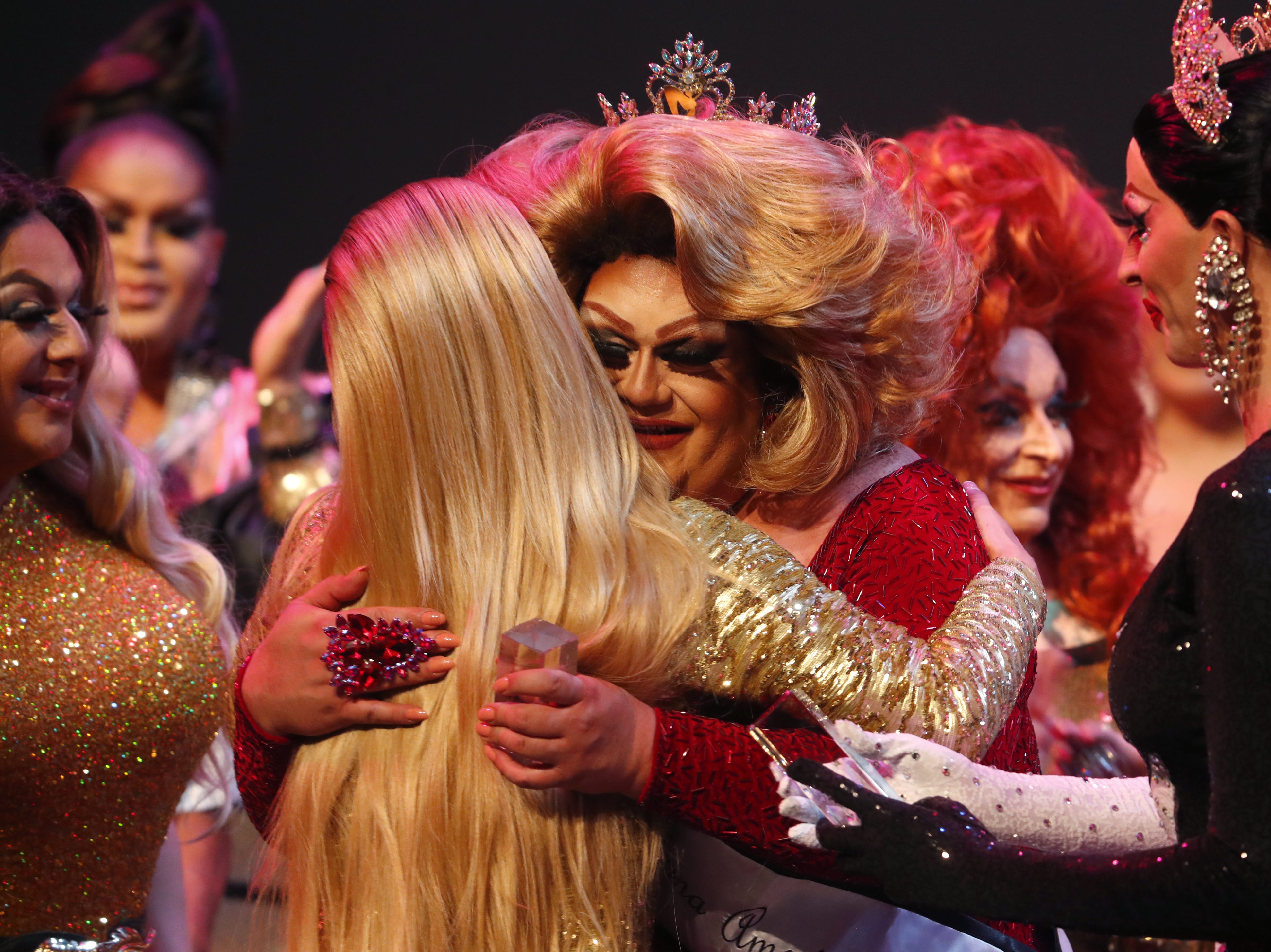 Espressa Grande receives hugs after winning the Miss Gay Arizona America pageant 2019 at Tempe Center for the Arts on May 11, 2019.