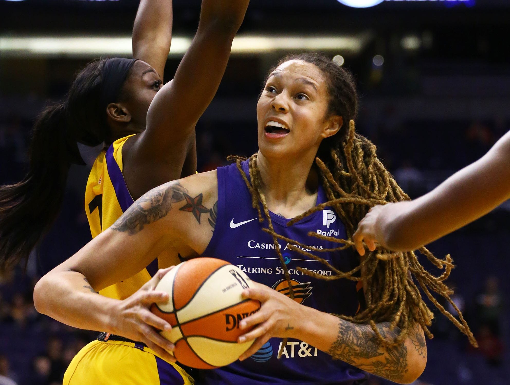 Phoenix Mercury center Brittney Griner drives to the basket against the Los Angeles Sparks in the first half during a preseason game on May 11, 2019 in Phoenix, Ariz.