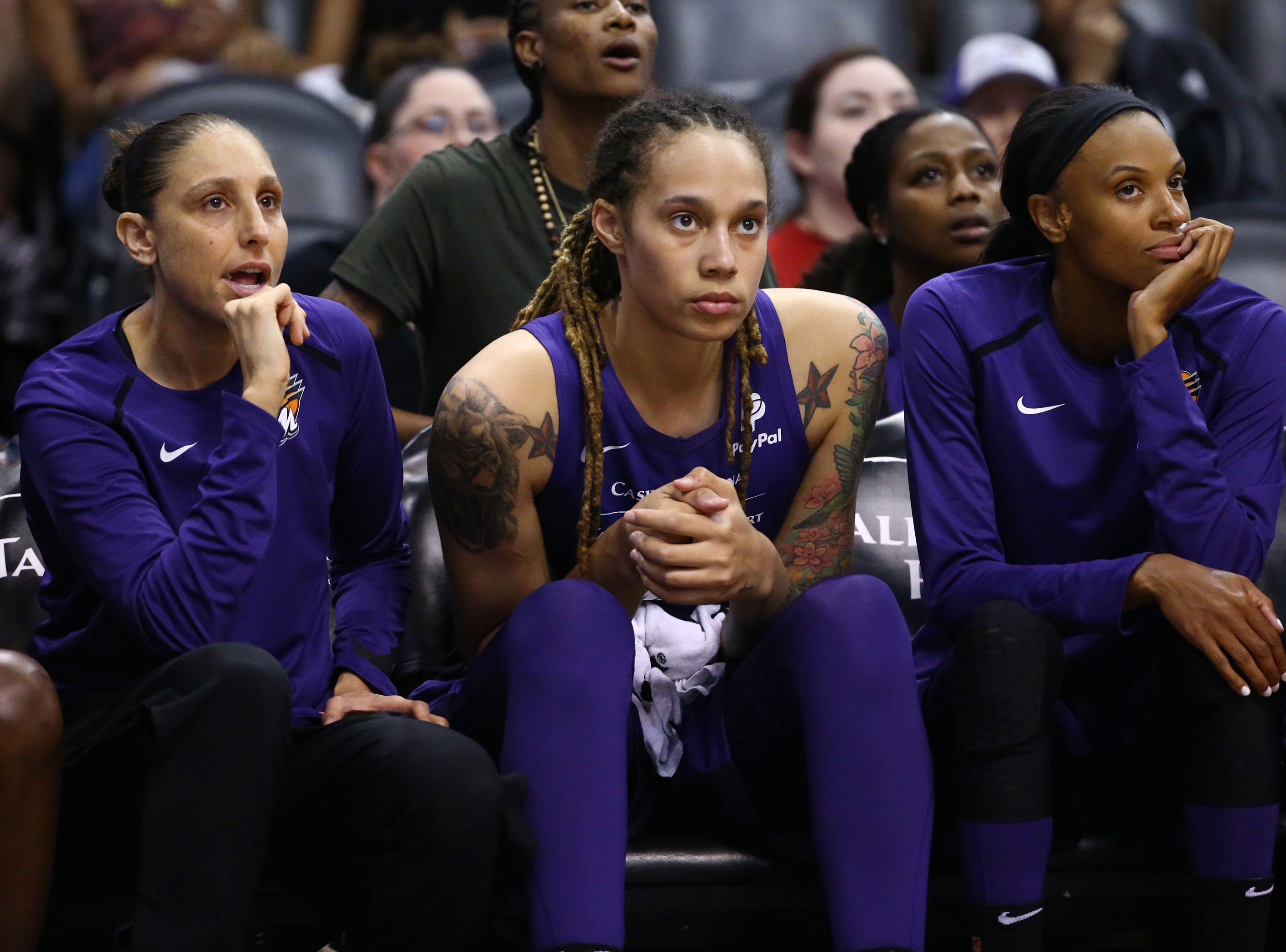 Phoenix Mercury guard Diana Taurasi watches the action from the bench with a back injury against the Los Angeles Sparks in the first half during a preseason game on May 11, 2019 in Phoenix, Ariz.