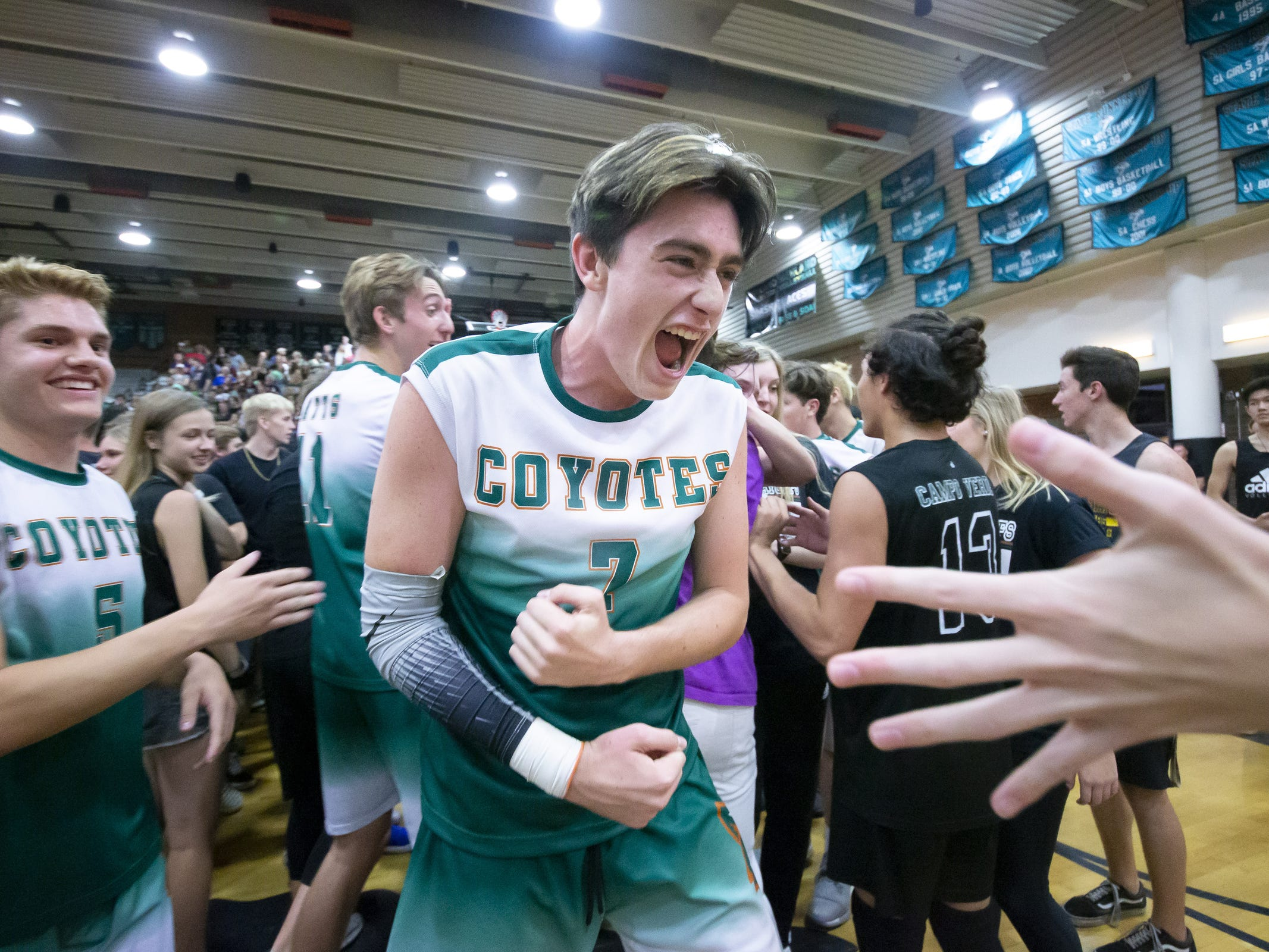 Senior middle blocker Kade Irvine (7) of the Campo Verde Coyotes celebrates Campo Verde's 3-0 win against the Tucson Mountain View Mountain Lions in the 5A Boys Volleyball State Championships at Higley High School on Saturday, May 11, 2019 in Gilbert, Arizona.