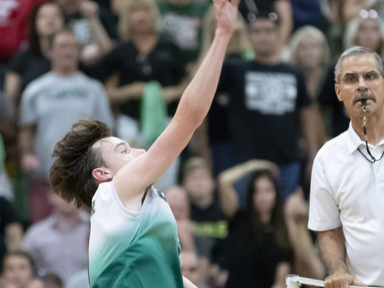 Junior outside hitter Jesse Lowder (9) of the Campo Verde Coyotes sets during the 5A Boys Volleyball State Championships against the Tucson Mountain View Mountain Lions at Higley High School on Saturday, May 11, 2019 in Gilbert, Arizona.
