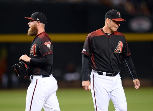 May 11, 2019; Phoenix, AZ, USA; Arizona Diamondbacks relief pitcher Archie Bradley (25) is removed from the game by manager Torey Lovullo (17) during the eighth inning against the Atlanta Braves at Chase Field.