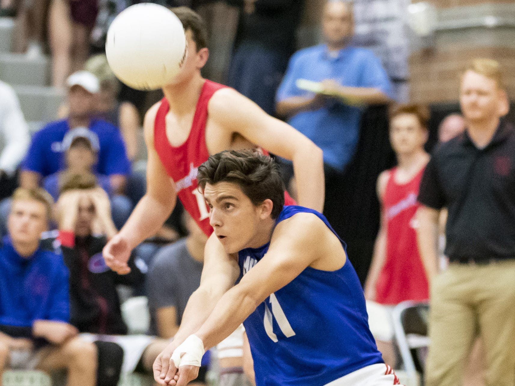 Senior libero Brigham Goodman (11) of the Mesa Mountain View Toros passes during the 6A Boys Volleyball State Championships against the Chandler Wolves at Higley High School on Saturday, May 11, 2019 in Gilbert, Arizona.