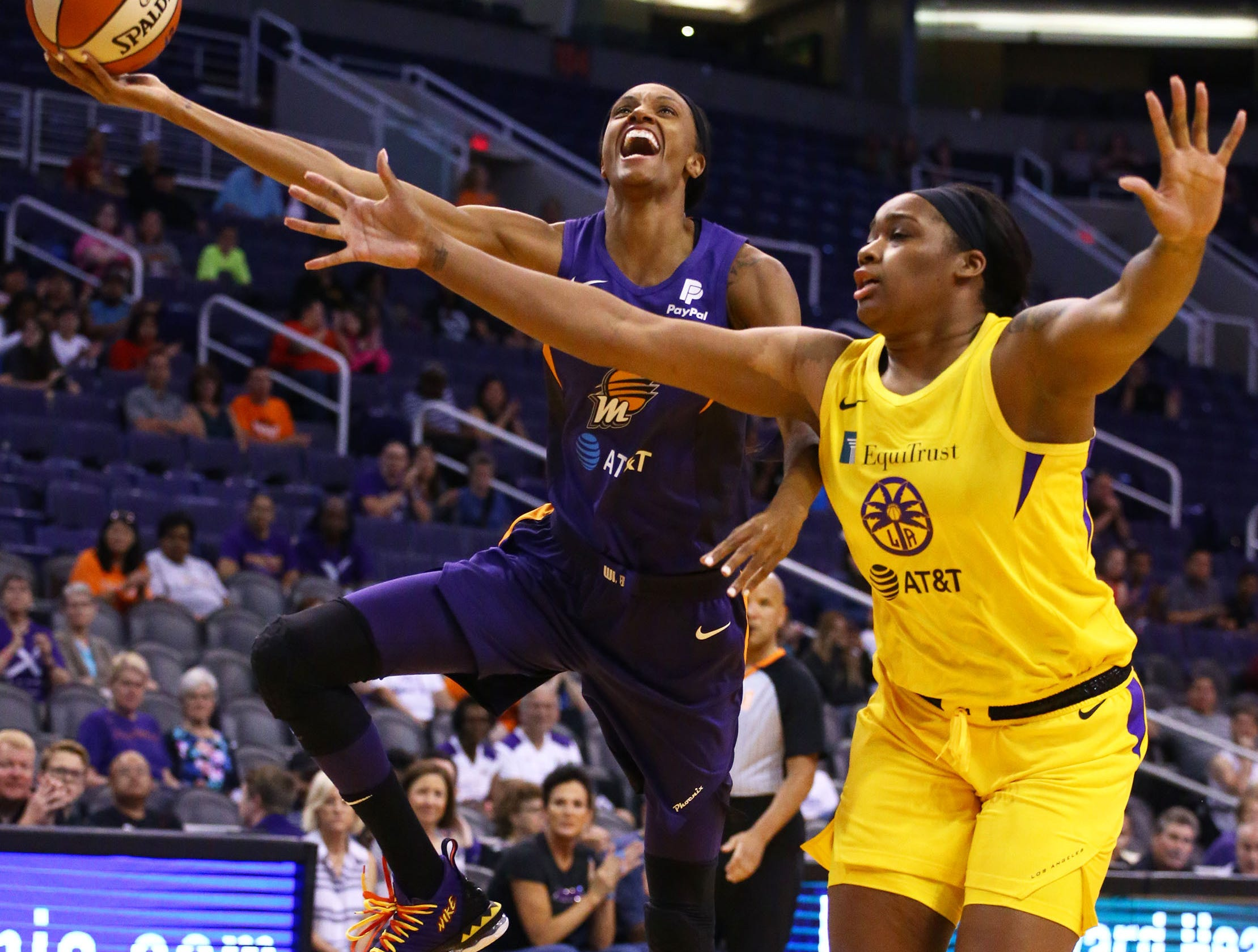 Phoenix Mercury forward DeWanna Bonner is guarded by Los Angeles Sparks center Rachel Hollivay in the first half during a preseason game on May 11, 2019 in Phoenix, Ariz.