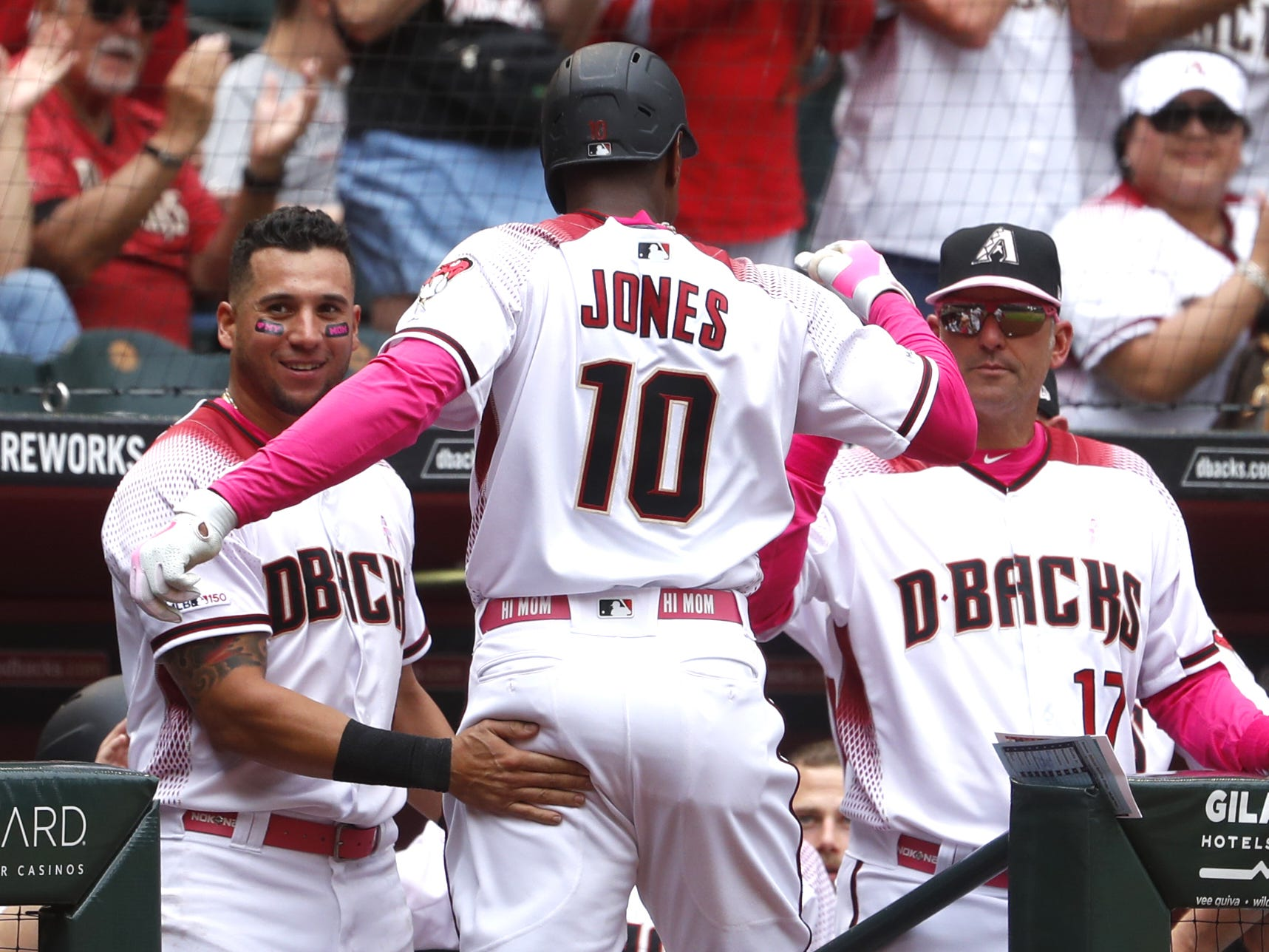 Diamondbacks' Adam Jones (10) celebrates his two-run homer with David Peralta (6) during the fourth inning against the Braves at Chase Field in Phoenix, Ariz. on May 12, 2019.