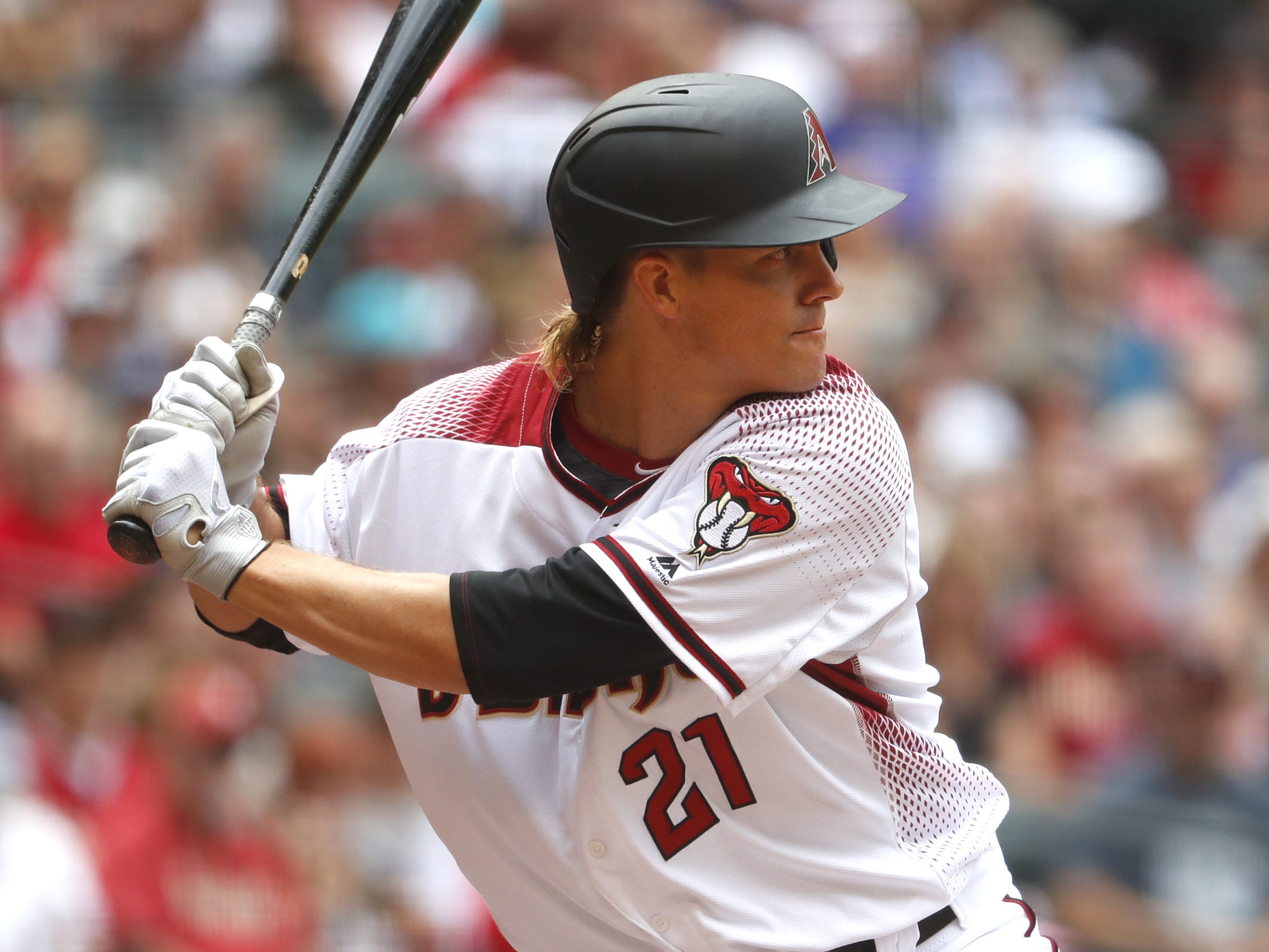 Diamondbacks' Zack Greinke (21) takes to the batters box against the Braves at Chase Field in Phoenix, Ariz. on May 12, 2019.