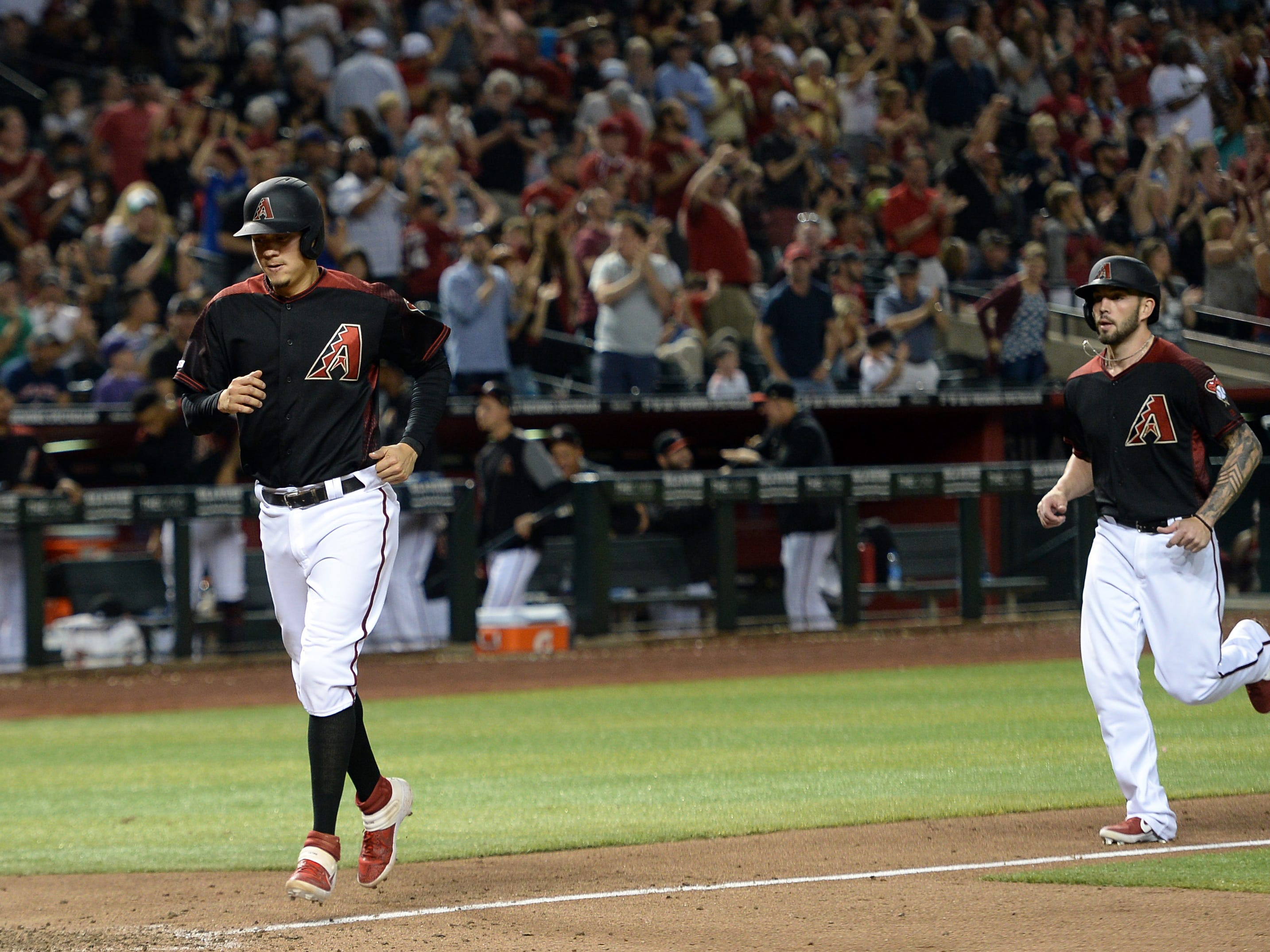 May 11, 2019; Phoenix, AZ, USA; Arizona Diamondbacks third baseman Wilmer Flores (41) and catcher Blake Swihart (19) approach home plate after a two run home run by Swihart against the Atlanta Braves during the eighth inning at Chase Field.