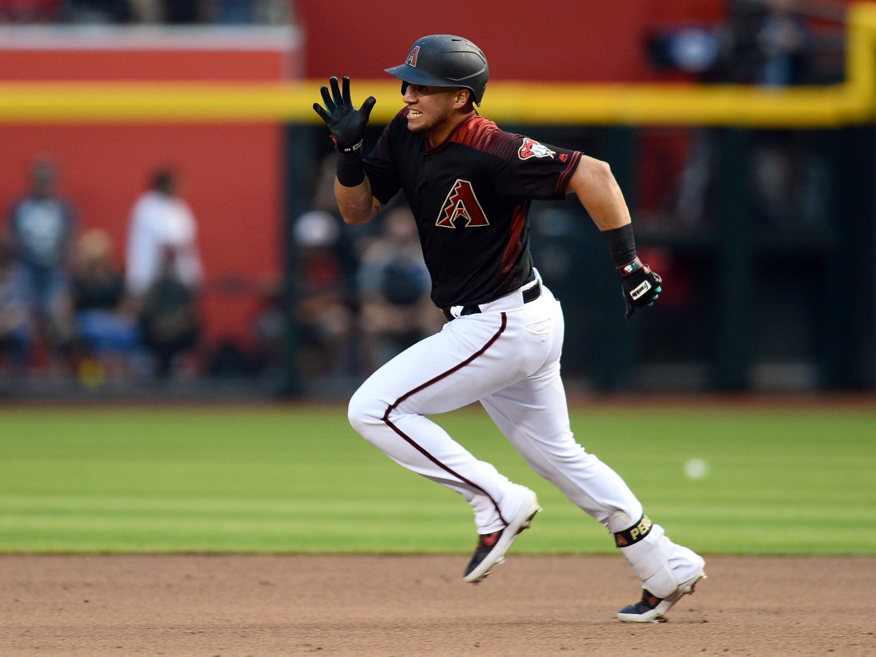 May 11, 2019; Phoenix, AZ, USA; Arizona Diamondbacks right fielder David Peralta (6) runs to second for a double against the Atlanta Braves during the sixth inning at Chase Field.