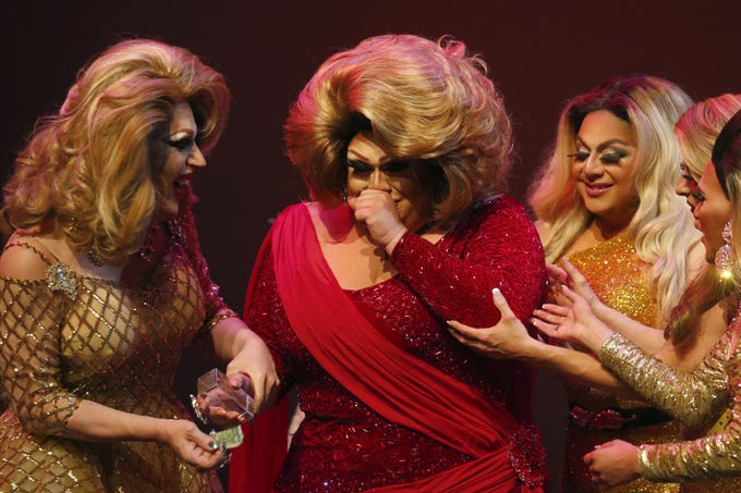 Espressa Grande (center) reacts after winning the Miss Gay Arizona America pageant 2019 at Tempe Center for the Arts on May 11, 2019.