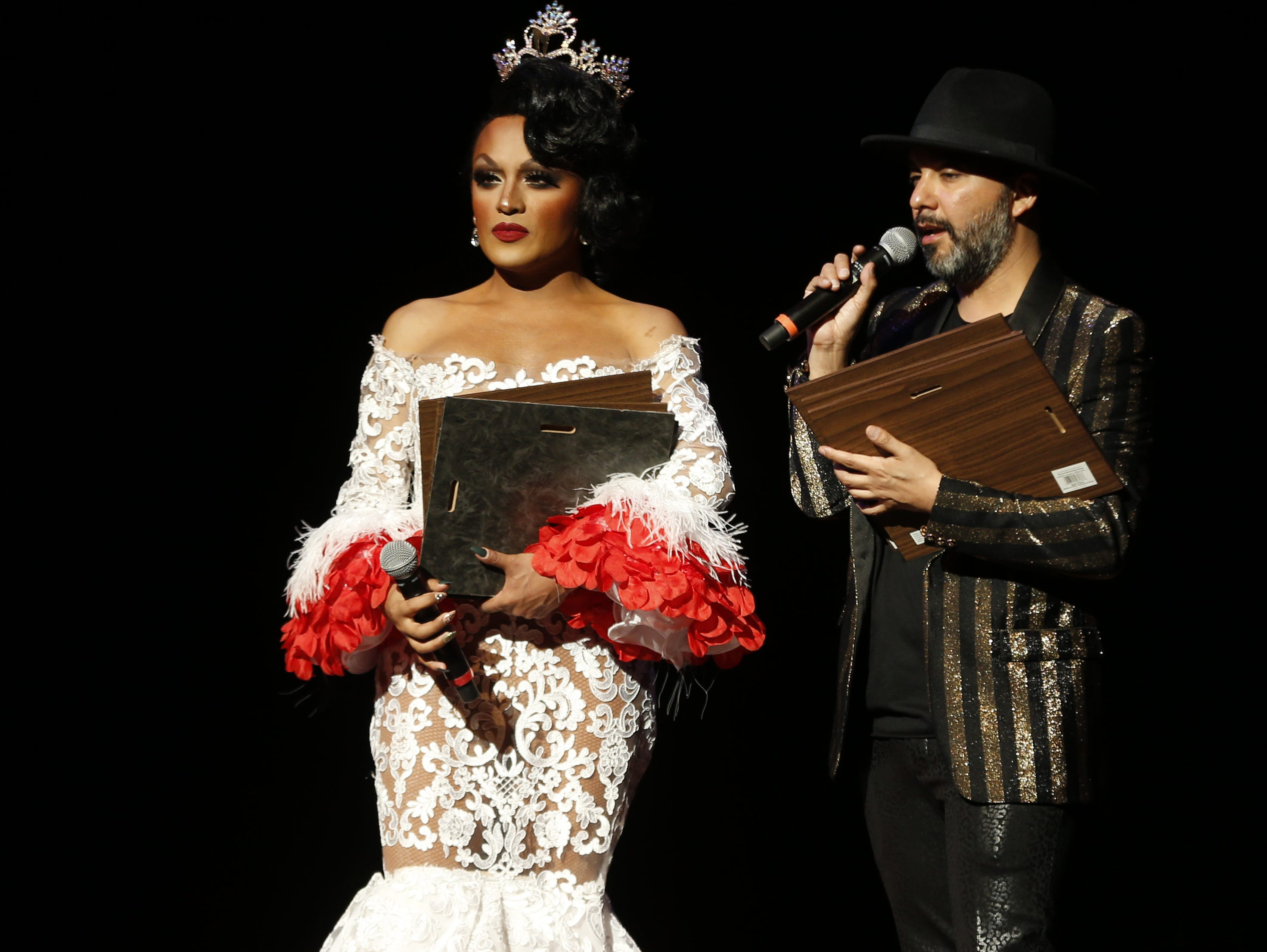 Miss Gay Arizona America 2018 Adriana Galliano (L) and Daniel Eckstrom give out awards during the Miss Gay Arizona America pageant 2019 at Tempe Center for the Arts on May 11, 2019.