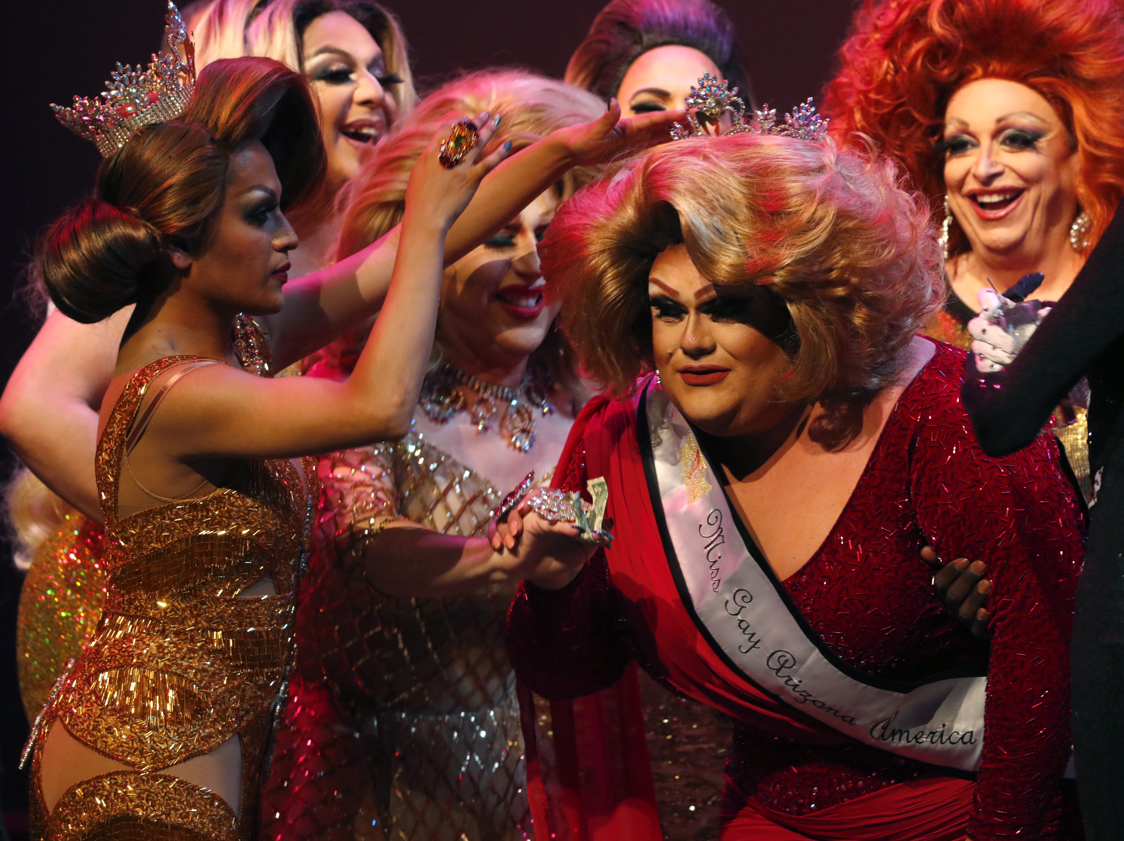 Espressa Grande is crowned by 2018 winner Adriana Galliano after Grande won the Miss Gay Arizona America pageant 2019 at Tempe Center for the Arts on May 11, 2019.