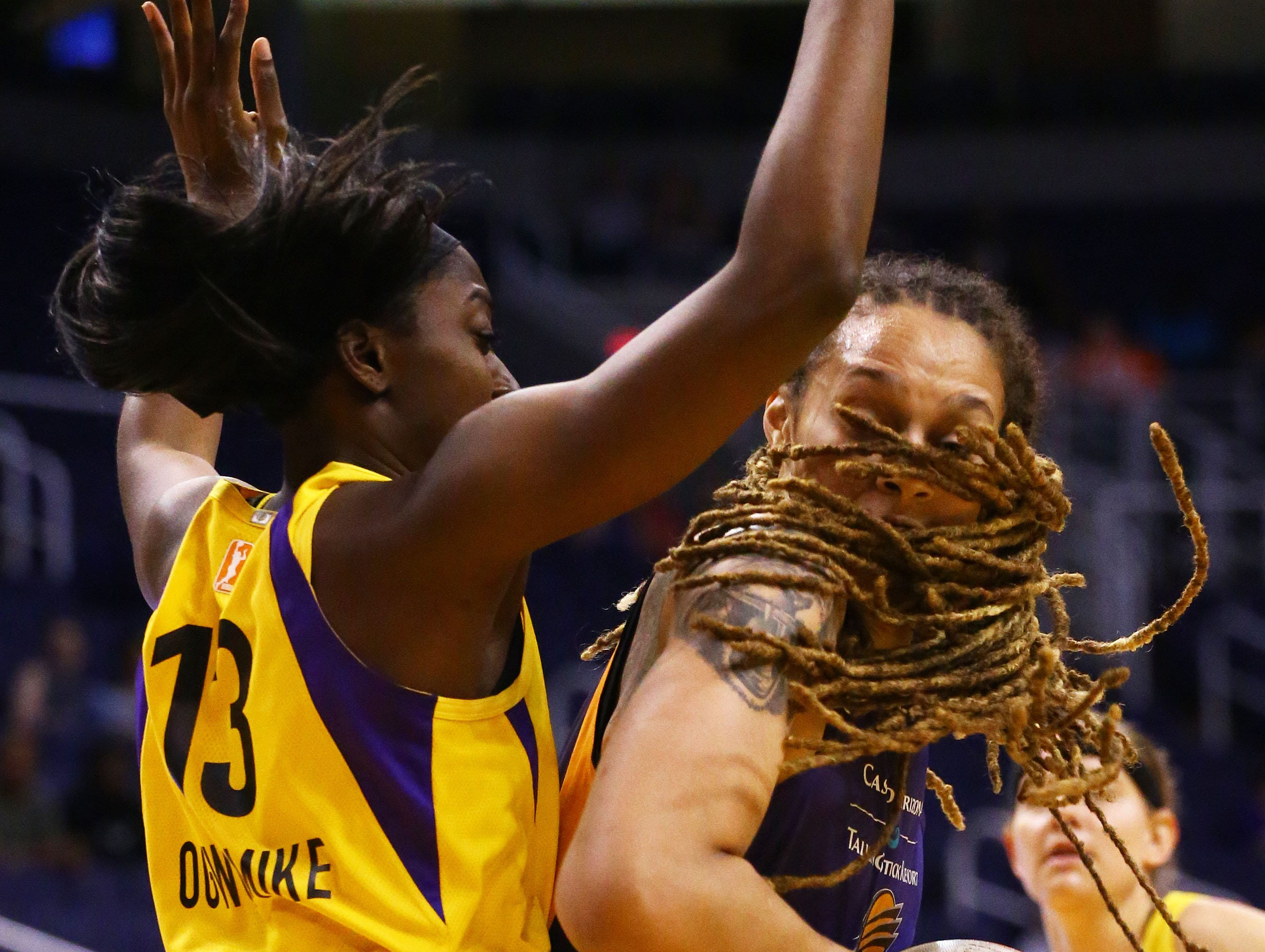 Phoenix Mercury center Brittney Griner is pressured by Los Angeles Sparks forward Chiney Ogwumike in the first half during a preseason game on May 11, 2019 in Phoenix, Ariz.