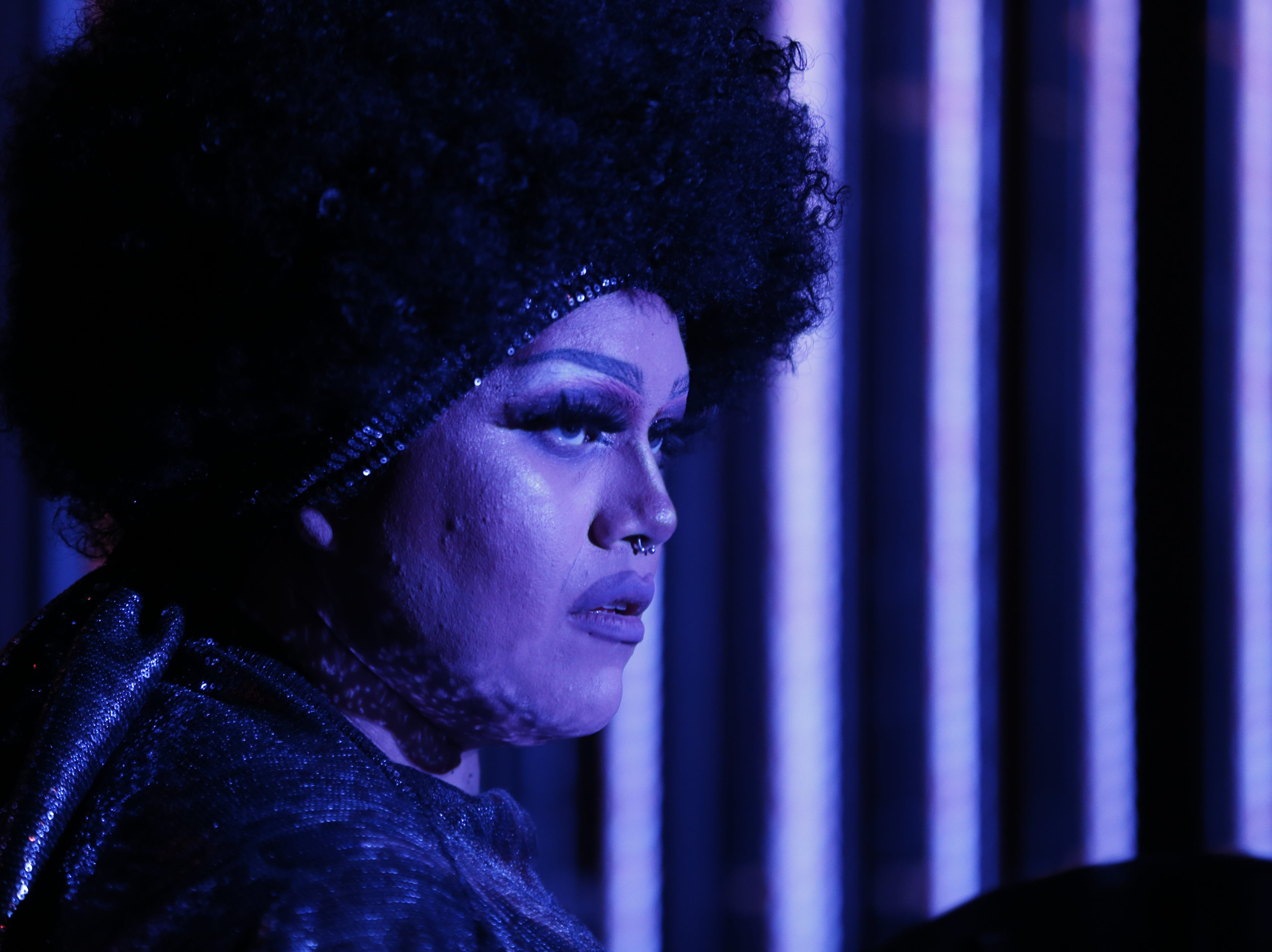 Isis D.Frost watches from backstage for as she waits for her performance during the Miss Gay Arizona America pageant 2019 at Tempe Center for the Arts on May 11, 2019.