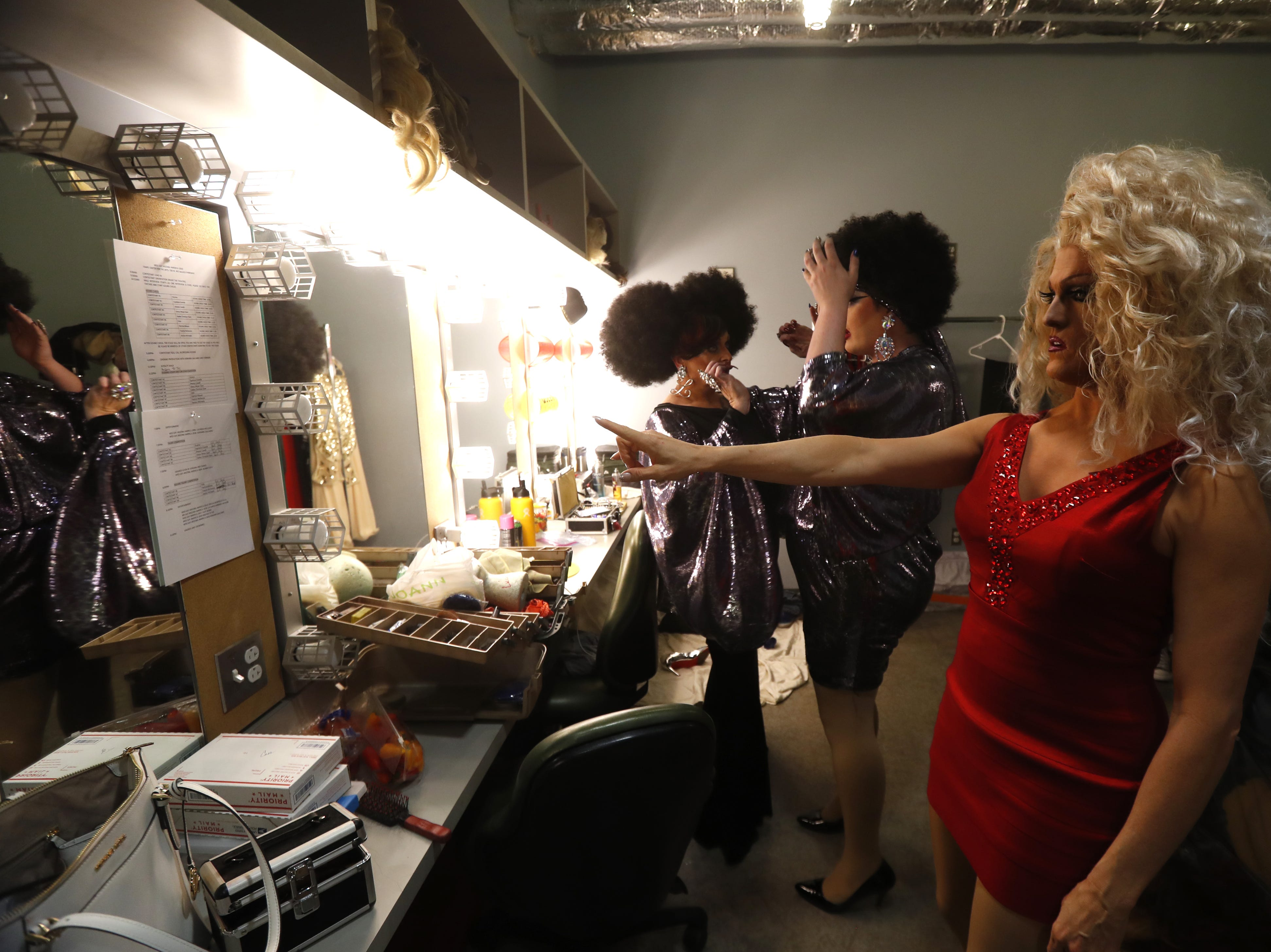 Lucinda Holliday (left), Queerella Deville and Bunny Fu Fu (right) prepare backstage for their performances during the Miss Gay Arizona America pageant 2019 at Tempe Center for the Arts on May 11, 2019.