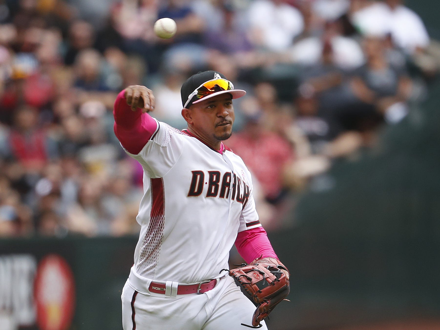 Diamondbacks' Eduardo Escobar throws to first base against the Braves during the seventh inning at Chase Field in Phoenix, Ariz. on May 12, 2019.