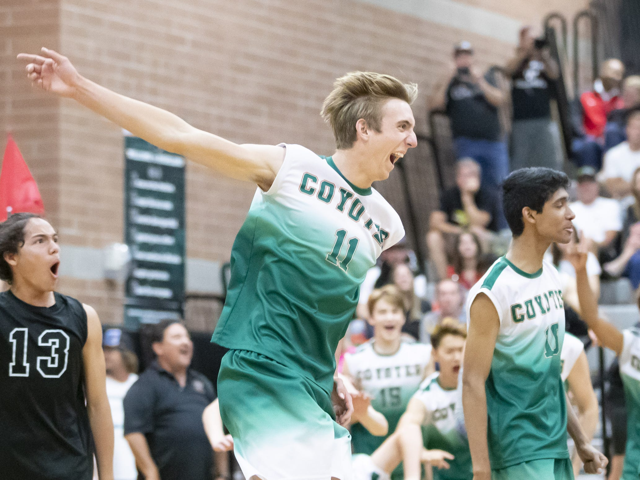 Junior middle blocker Tyler Watts (11) of the Campo Verde Coyotes celebrates Campo Verde's 3-0 win against the Tucson Mountain View Mountain Lions in the 5A Boys Volleyball State Championships at Higley High School on Saturday, May 11, 2019 in Gilbert, Arizona.
