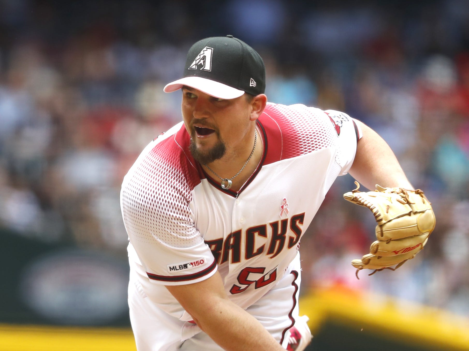 Diamondbacks' Zack Godley (52) pitches against the Braves during the first inning at Chase Field in Phoenix, Ariz. on May 12, 2019.
