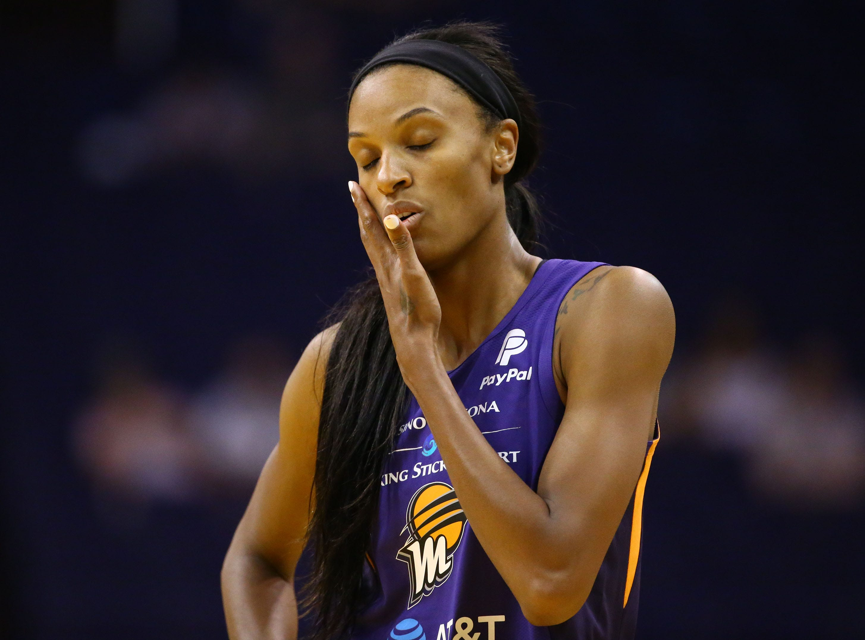 Phoenix Mercury forward DeWanna Bonner reacts after being hit in the face against the Los Angeles Sparks in the first half during a preseason game on May 11, 2019 in Phoenix, Ariz.