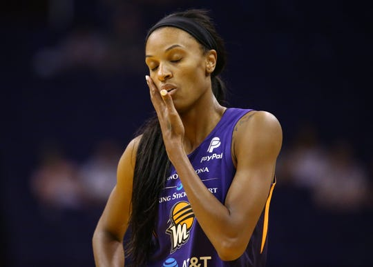 Mercury forward DeWanna Bonner reacts after getting his in the face during a preseason game against the Sparks on May 11 at Talking Stick Resort Arena.